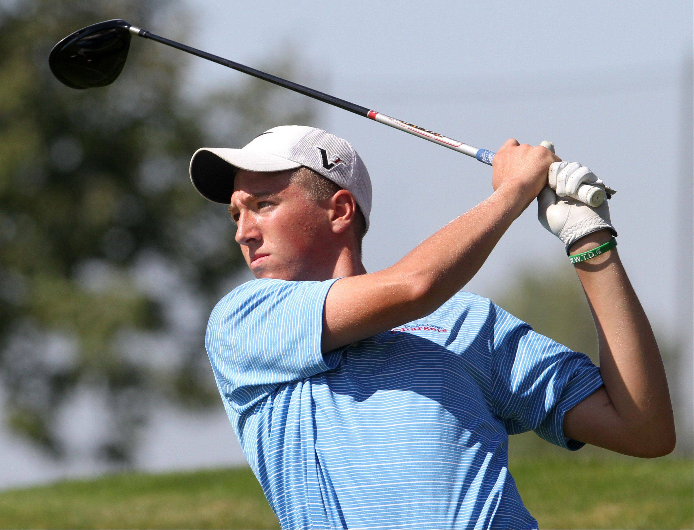 Dundee-Crown's Brenton Bartelt swings on No. in the Charger Classic boys golf invite, hosted by Dundee-Crown High School, at Randall Oaks Golf Club in West Dundee on Saturday.