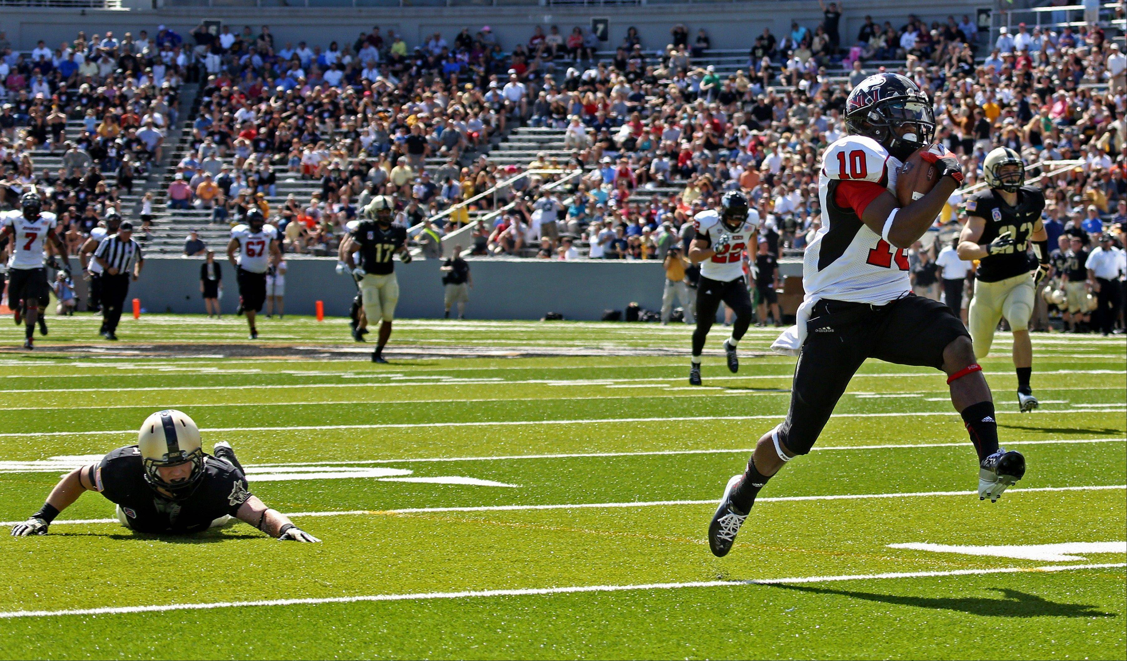 Northern Illinois' Tommylee Lewis runs for a touchdown past Army's Justin Trimble Saturday during the first half in West Point, N.Y.