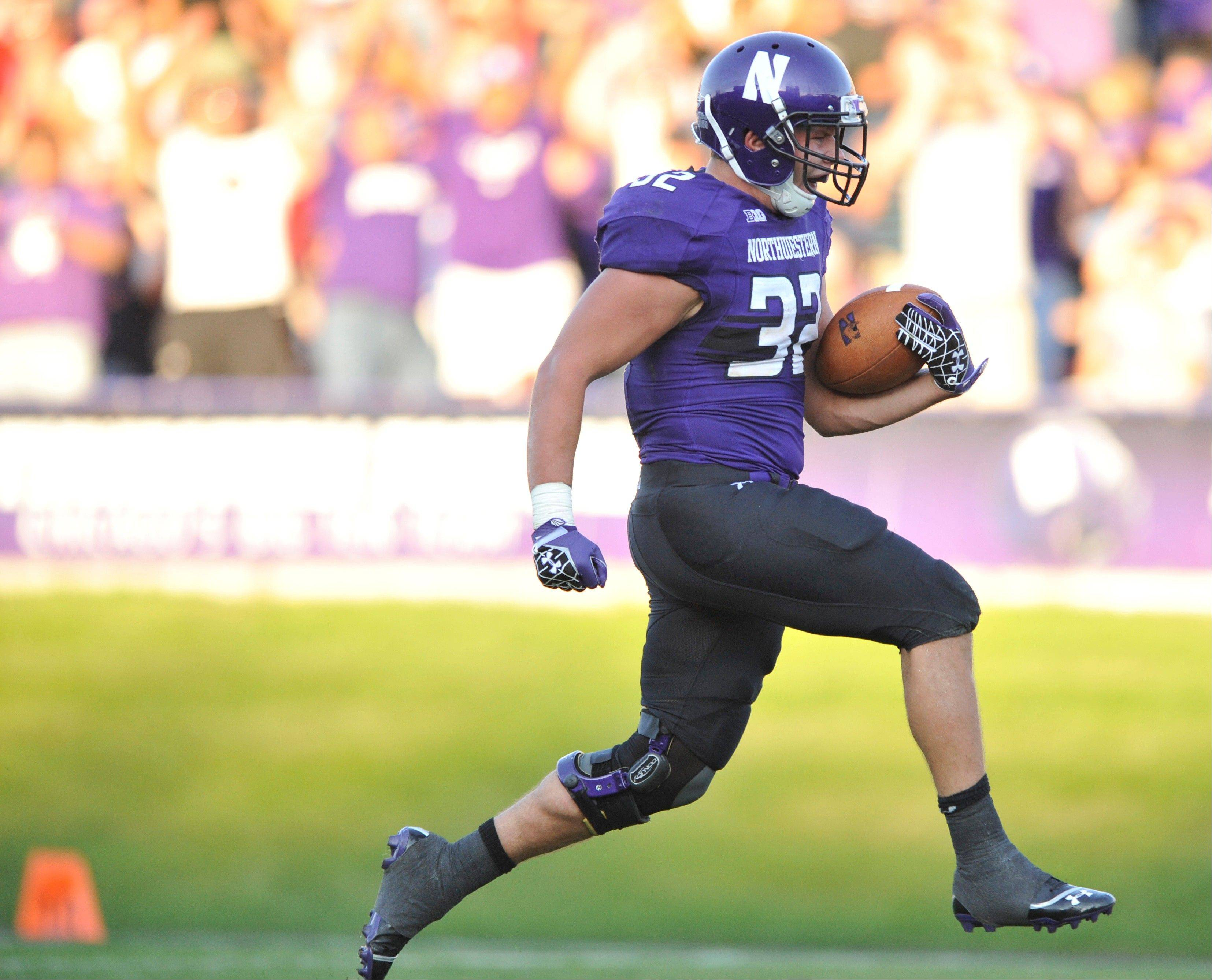 Northwestern running back Mike Trumpy runs for a touchdown Saturday during the fourth quarter against Boston College in Evanston. Northwestern won 22-13.