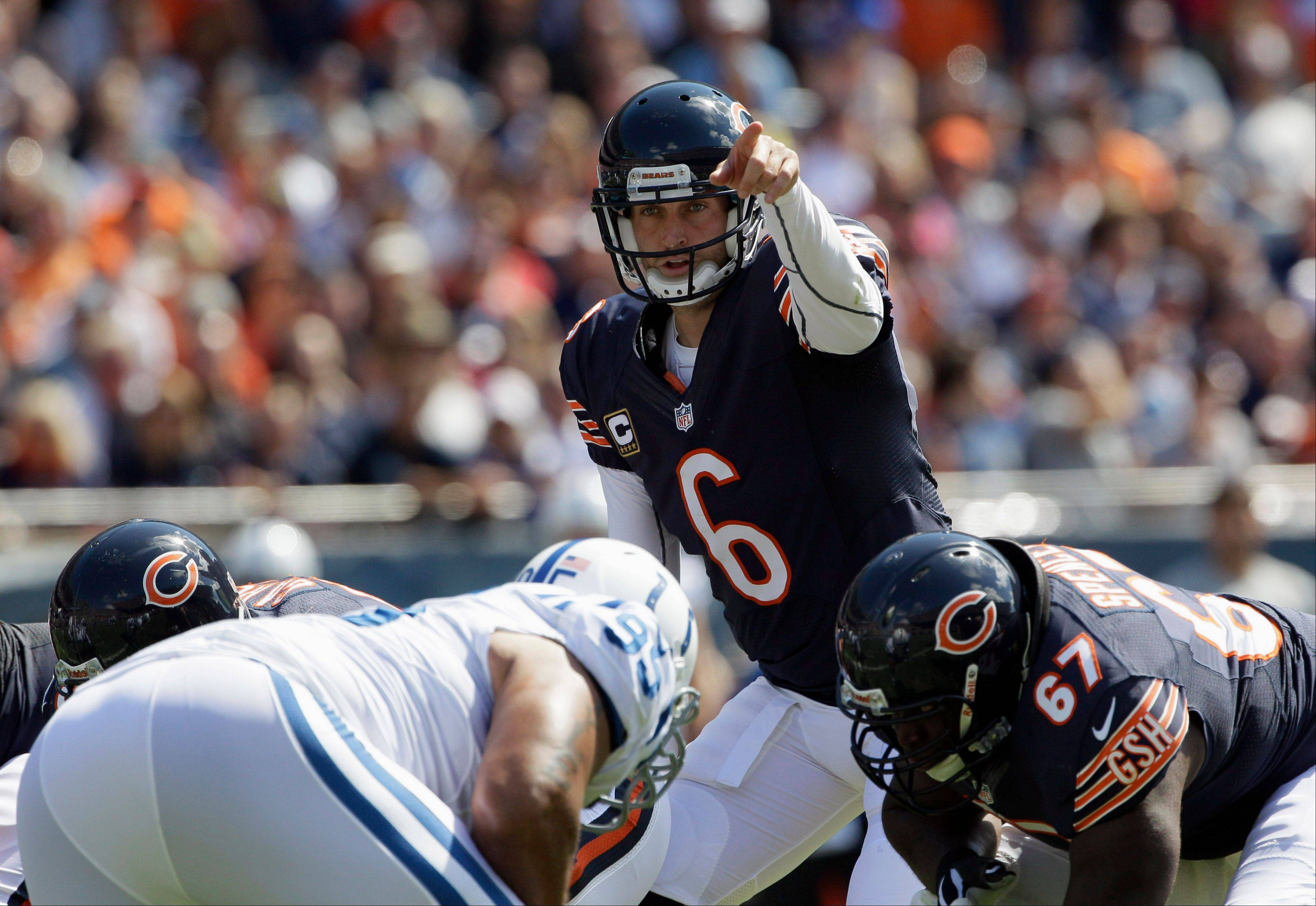 Chicago Bears quarterback Jay Cutler (6) points as he calls a play from the line of scrimmage against the Indianapolis Colts during the first half of an NFL football game in Chicago, Sunday, Sept. 9, 2012.