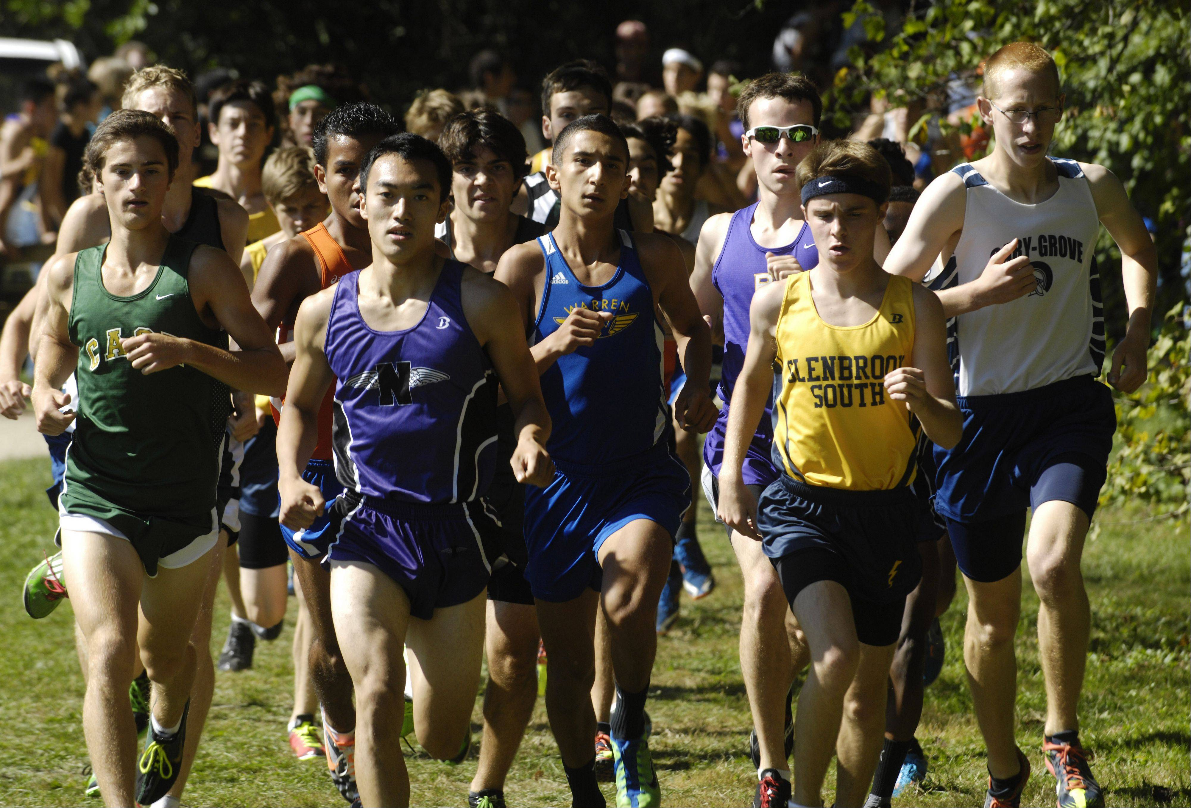 Runners are tightly grouped in the early stages of the boys' race during the Warren cross country invite in Gurnee on Saturday.