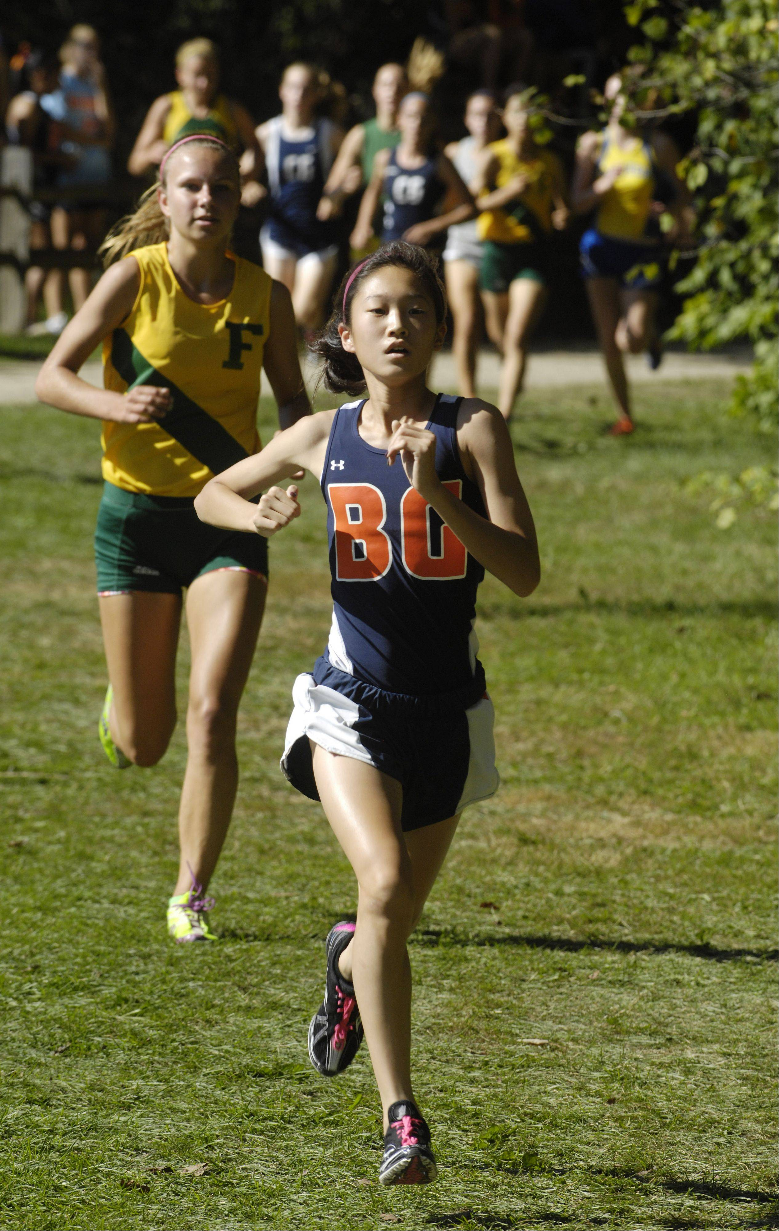 Buffalo Grove's Kaitlyn Ko leads Fremd's Kelly Breen on her way to victory at the Warren cross country invite in Gurnee on Saturday. Breen finished second and led the Vikings to the team title.