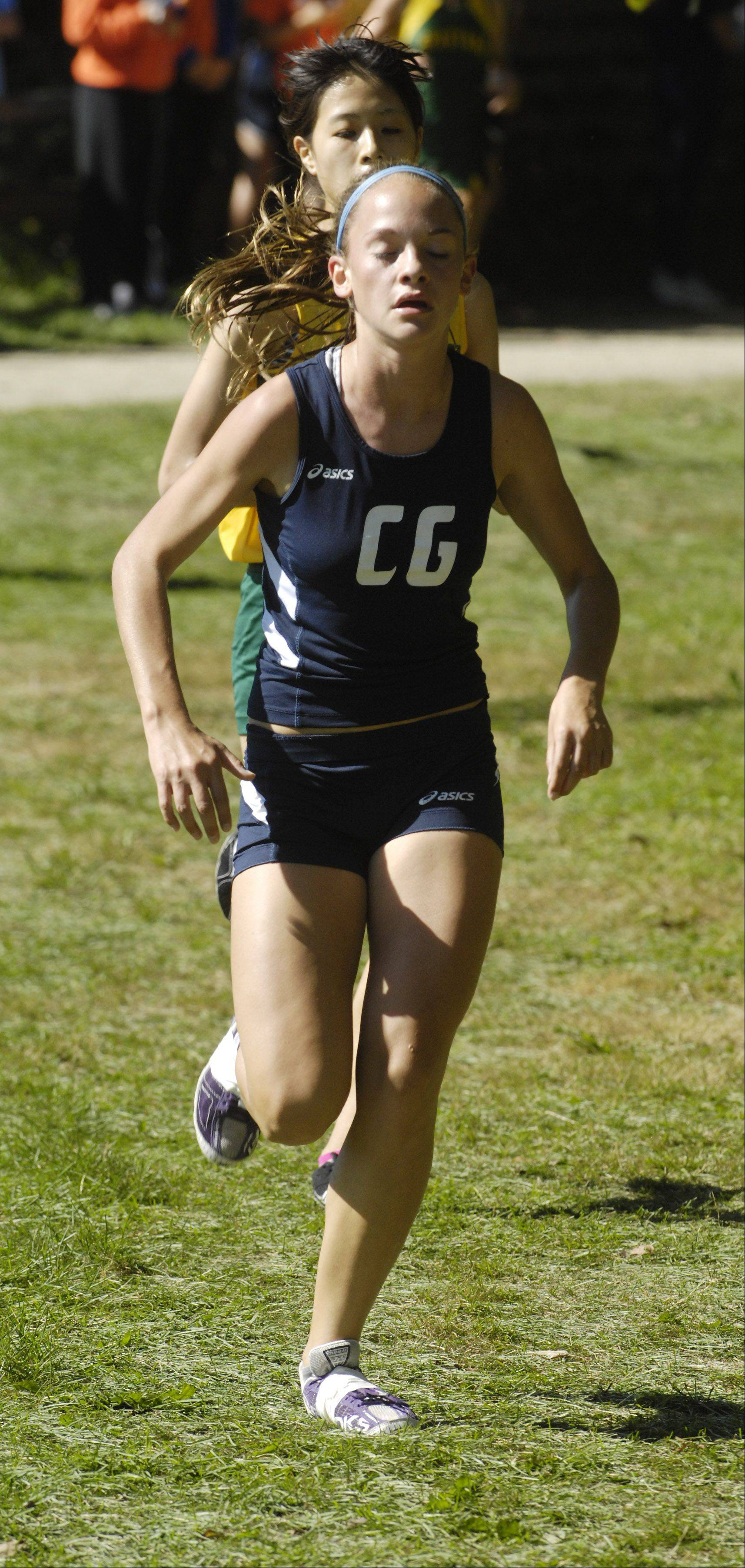 Cary-Grove's Talia Duzey runs toward a third-place individual finish during the Warren cross country invite in Gurnee Saturday.
