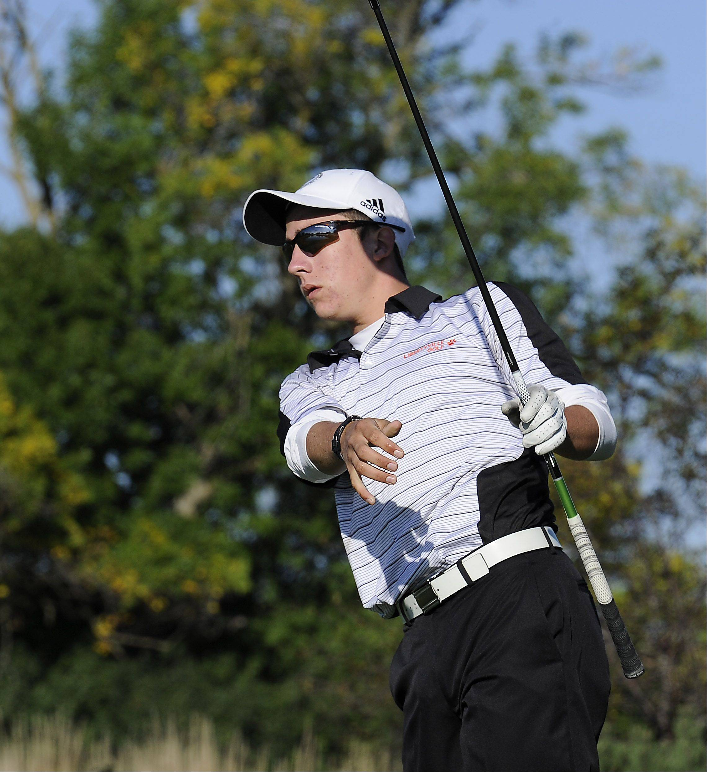 Libertyvilles's Peter Henderson tees off on No. 4 at the Wheeling Invitational on Saturday at Chevy Chase.