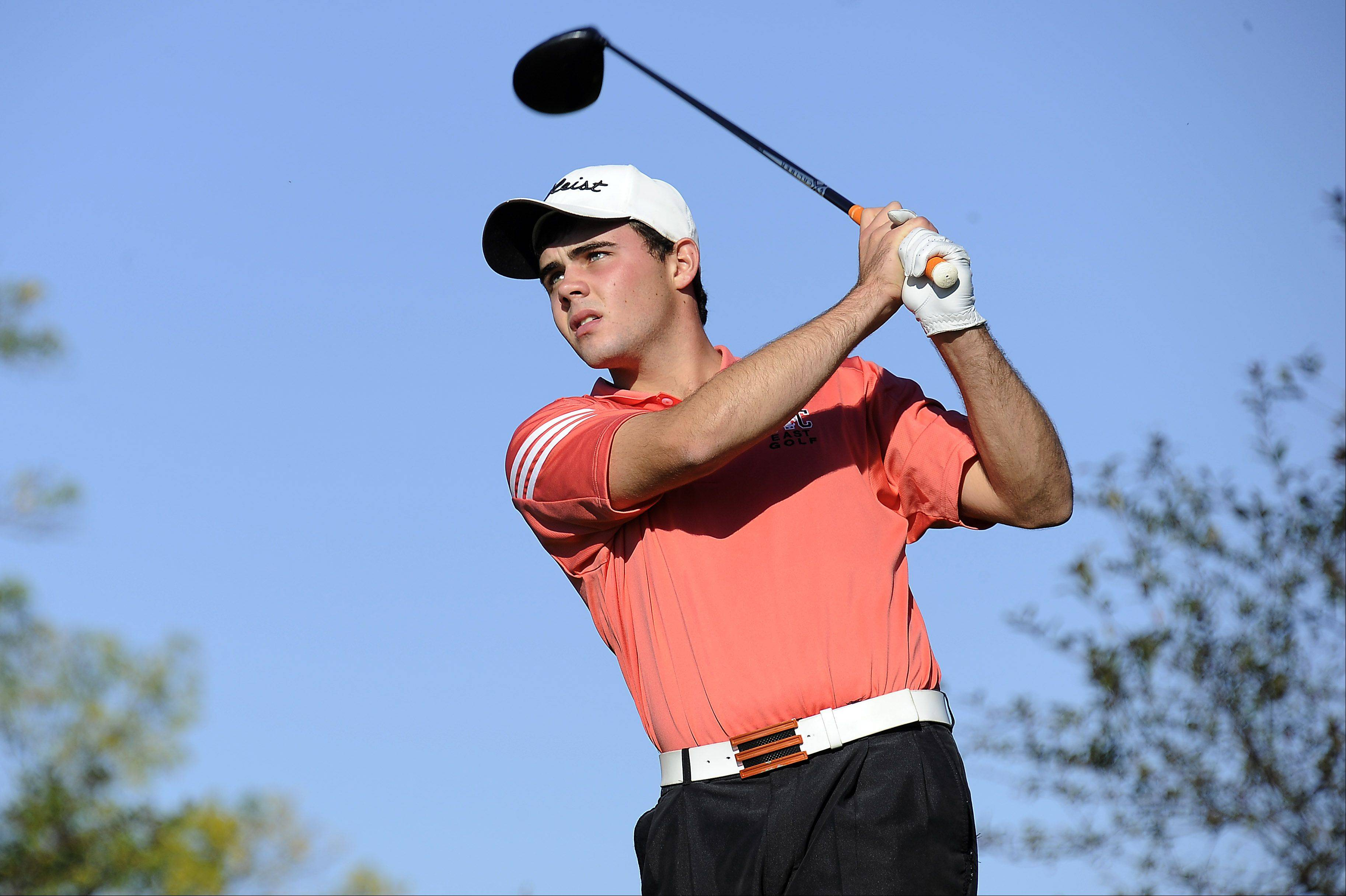 St. Charles East's Max Kelly tees off on hole No. 4 at the Wheeling Invitational on Saturday.