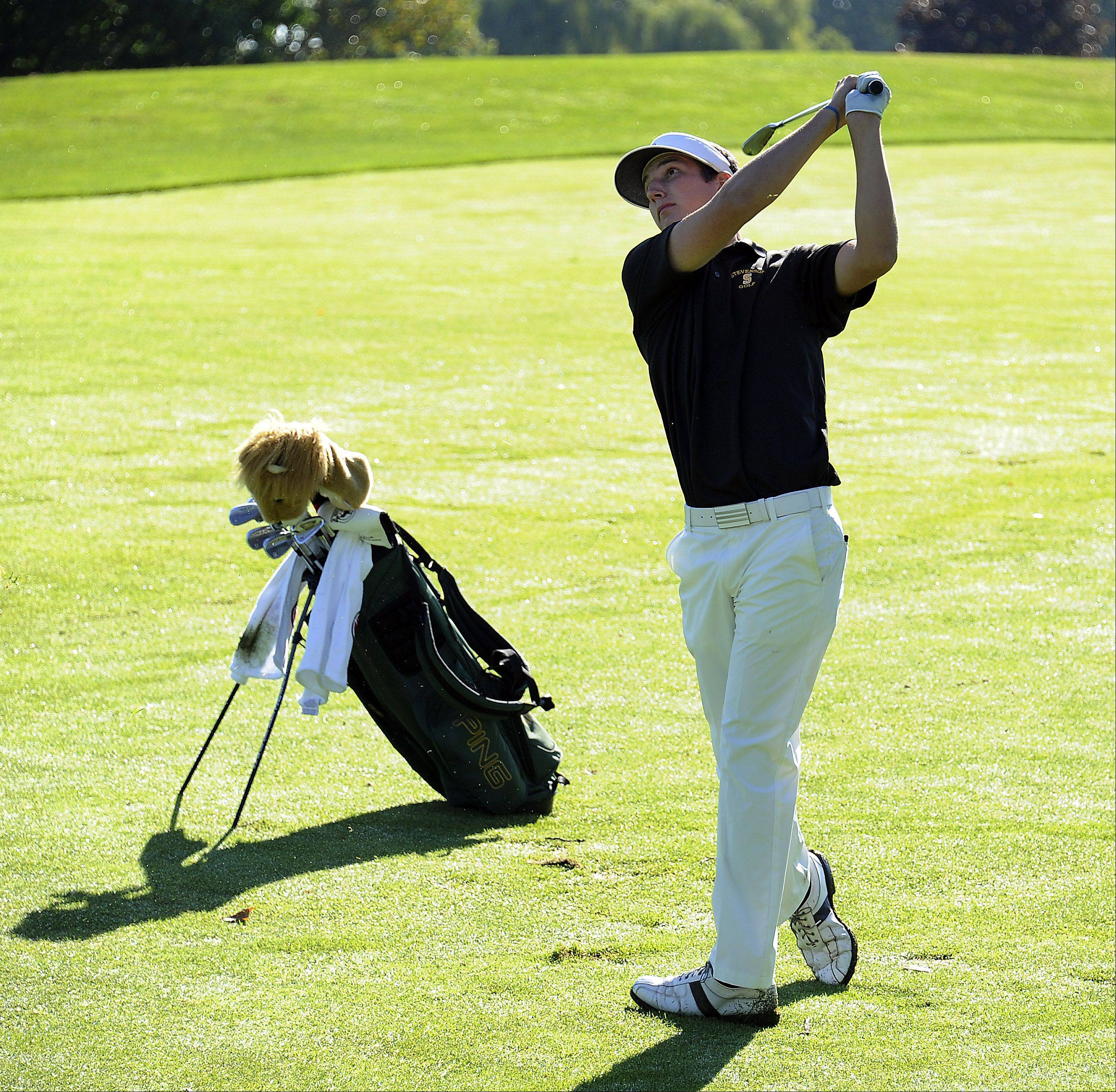 Stevenson's Jack Spellman chips on the green at No. 5 during the Wheeling Invitational on Saturday.
