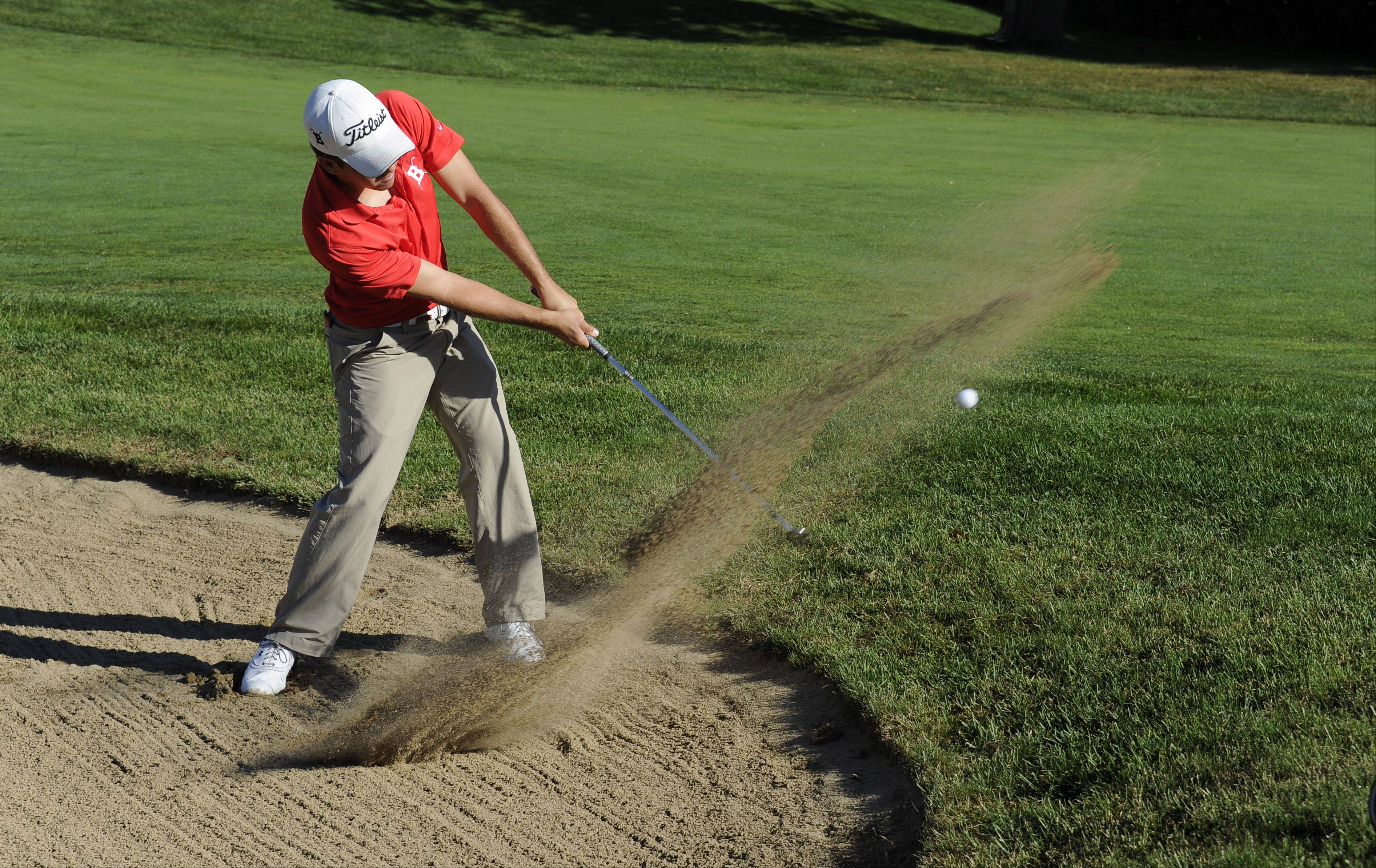 Barrington's Greg Conrad hits out of a sand trap on No. 4 during the Wheeling Invitational on Saturday.