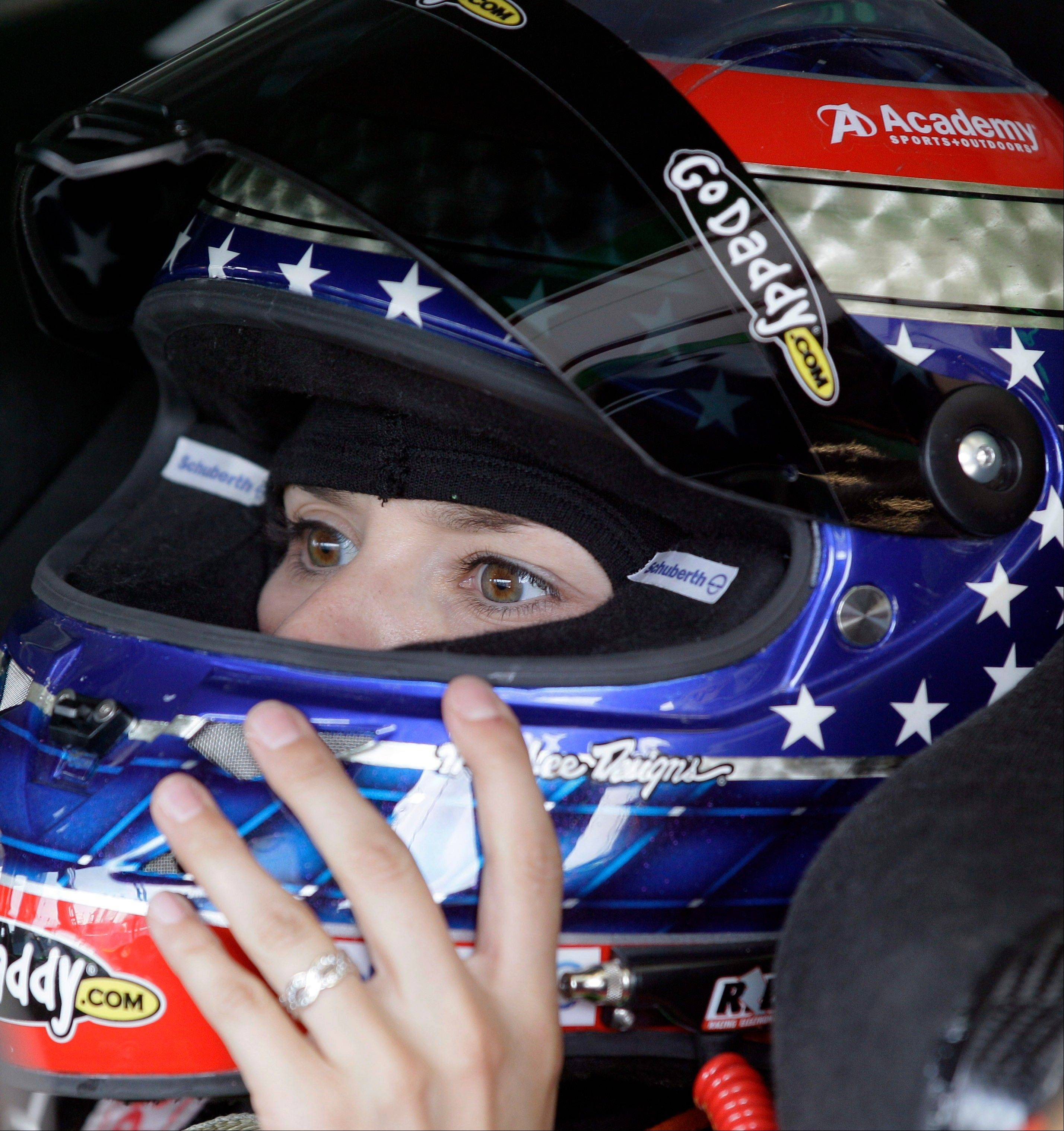 Danica Patrick checks her helmet during practice Friday for the NASCAR Sprint Cup Series auto race at Chicagoland Speedway in Joliet.