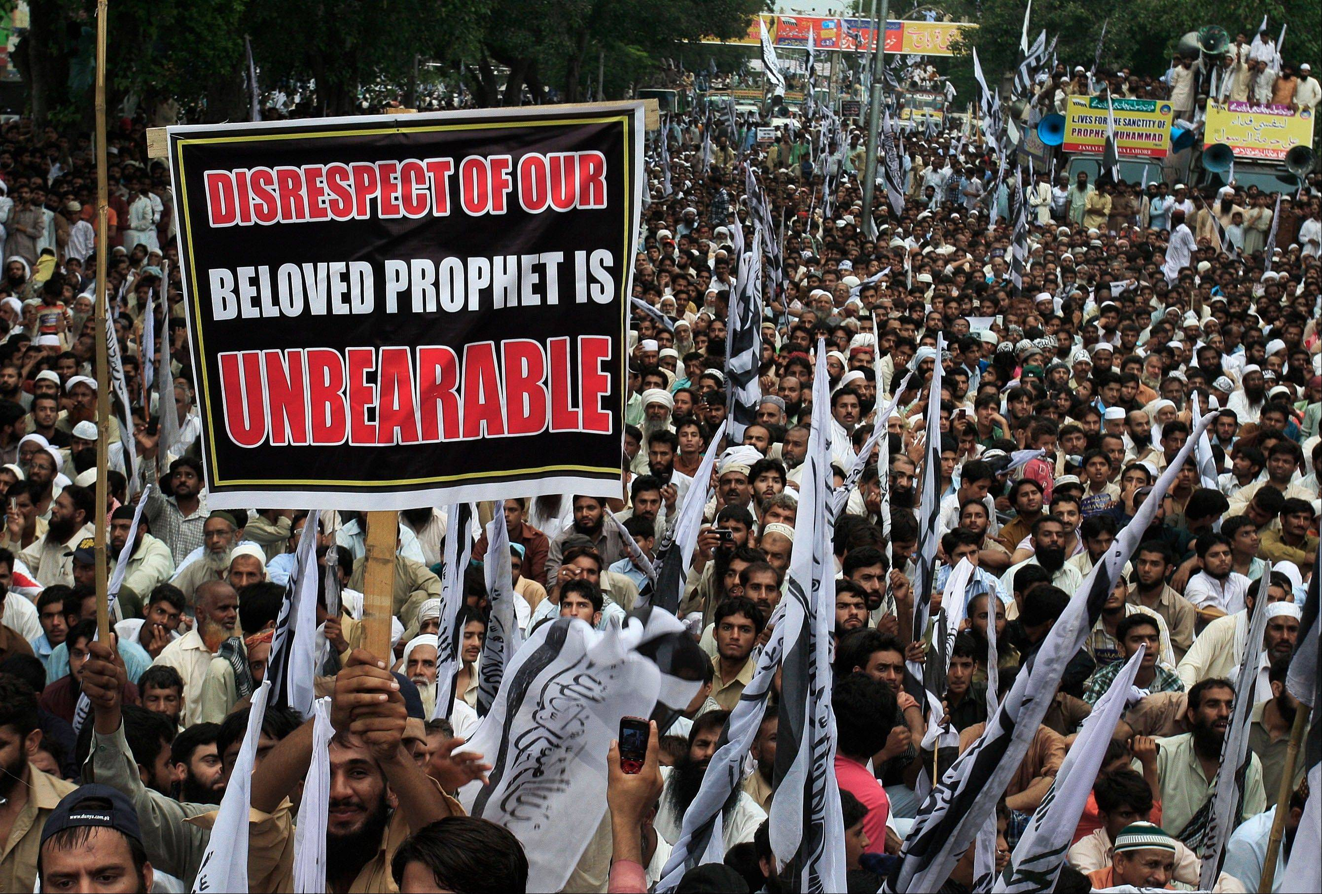 Thousands of supporters of a Pakistani religious group Jammat-Ud-Dawa Tehreek-e-Insaf or Movement for Justice take part in a demonstration in Lahore, Pakistan, Sunday, as part of widespread anger across the Muslim world over a film ridiculing Islam�s Prophet Muhammad.