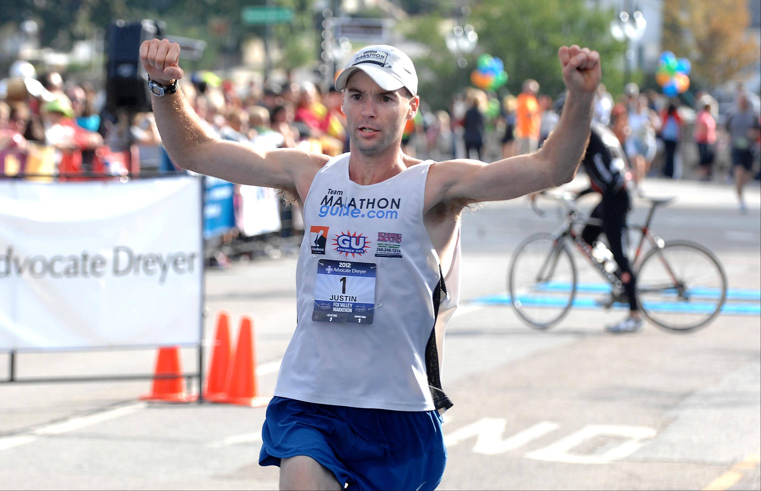 With a record-setting time, Justin Gillette of Goshen, Ind., finishes the Fox Valley Marathon in first place Sunday in St. Charles. The first 30 finishers qualified for the prestigious Boston Marathon.