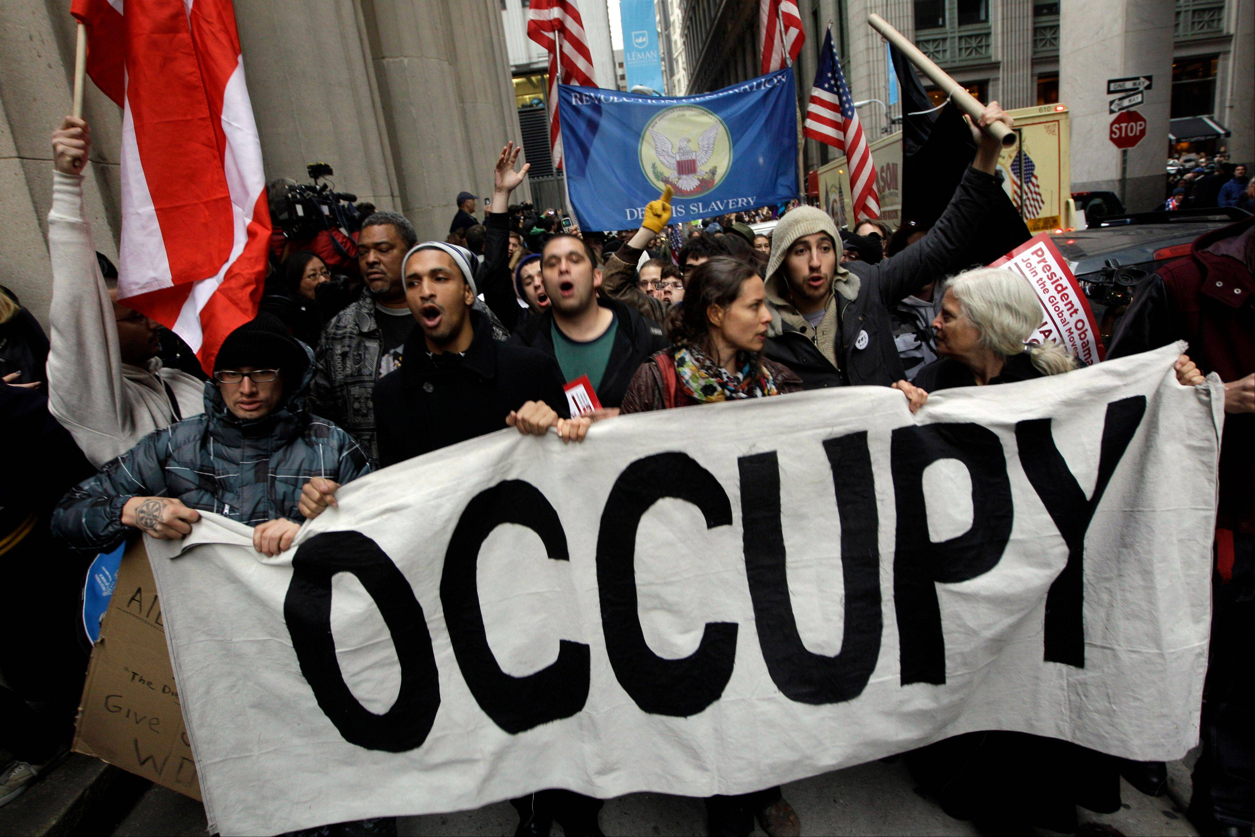 Demonstrators affiliated with the Occupy Wall Street movement march through the streets of the financial district Nov. 17, 2011, in New York.