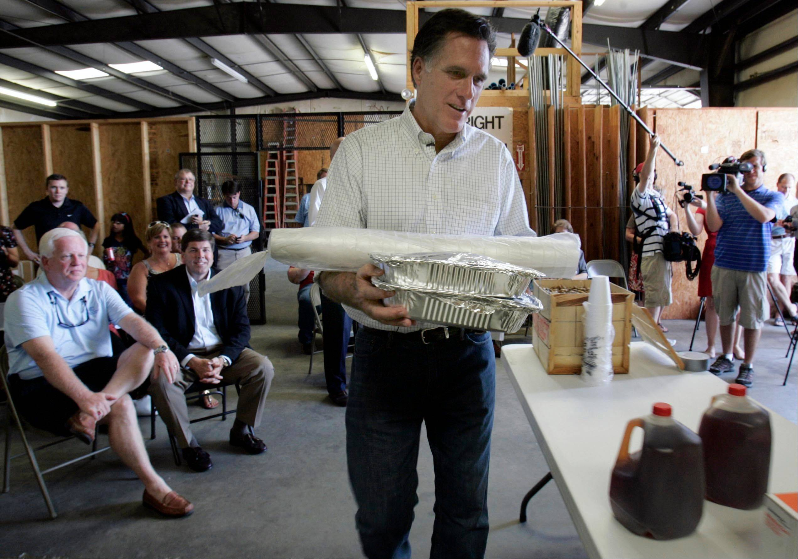 Mitt Romney arrives with lunch to speak with a group of small business owners on the economy during a visit to Meetze plumbing in Irmo, S.C. In an election year when the economy and small business have combined to form a huge campaign issue, advocacy groups like the Small Business & Entrepreneurship Council step up their own campaigns on behalf of the company owners they represent.