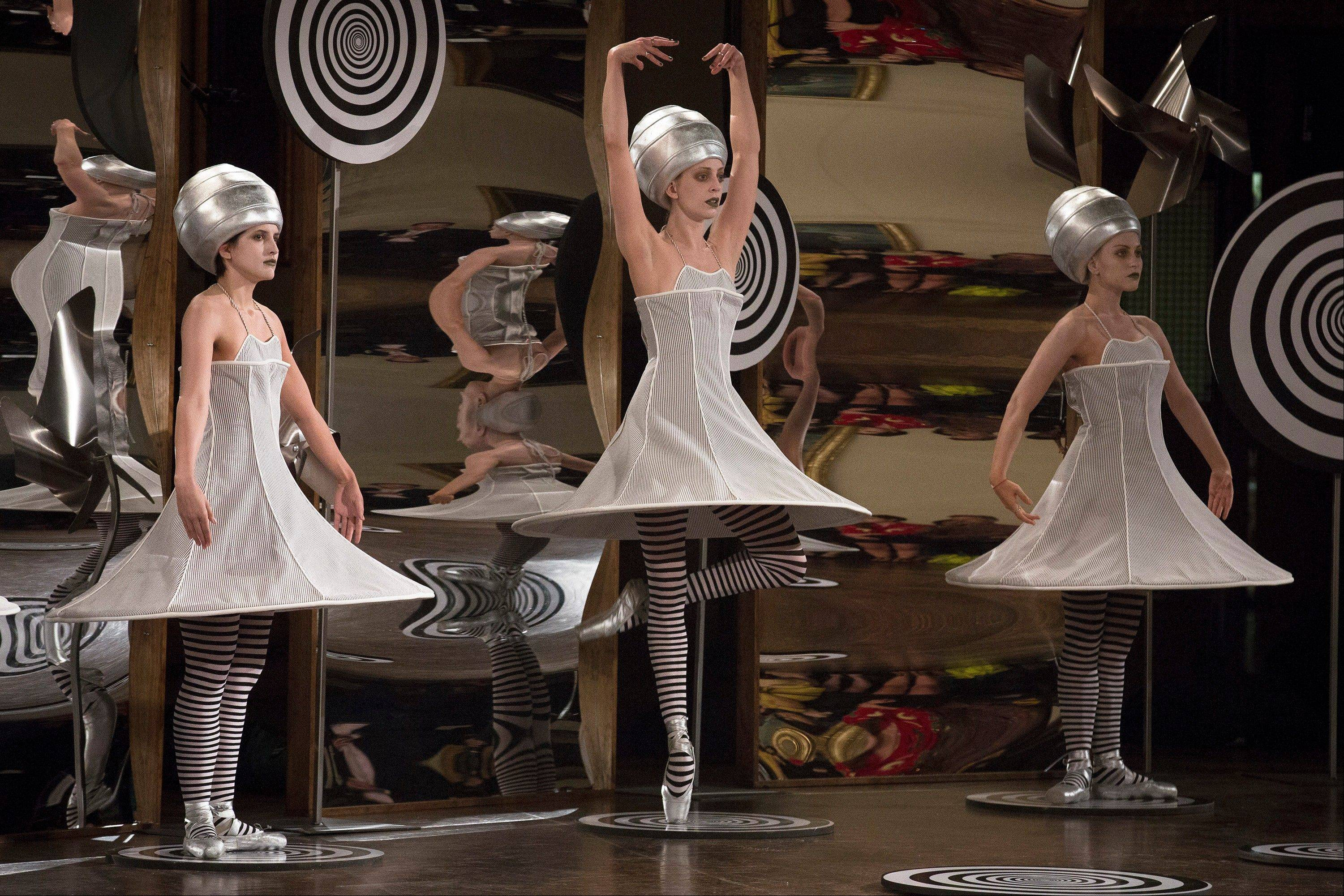 Dancers perform in the background of the presentation space moments before the Thom Browne Spring 2013 collection is modeled during Fashion Week in New York, Monday, Sept. 10, 2012.