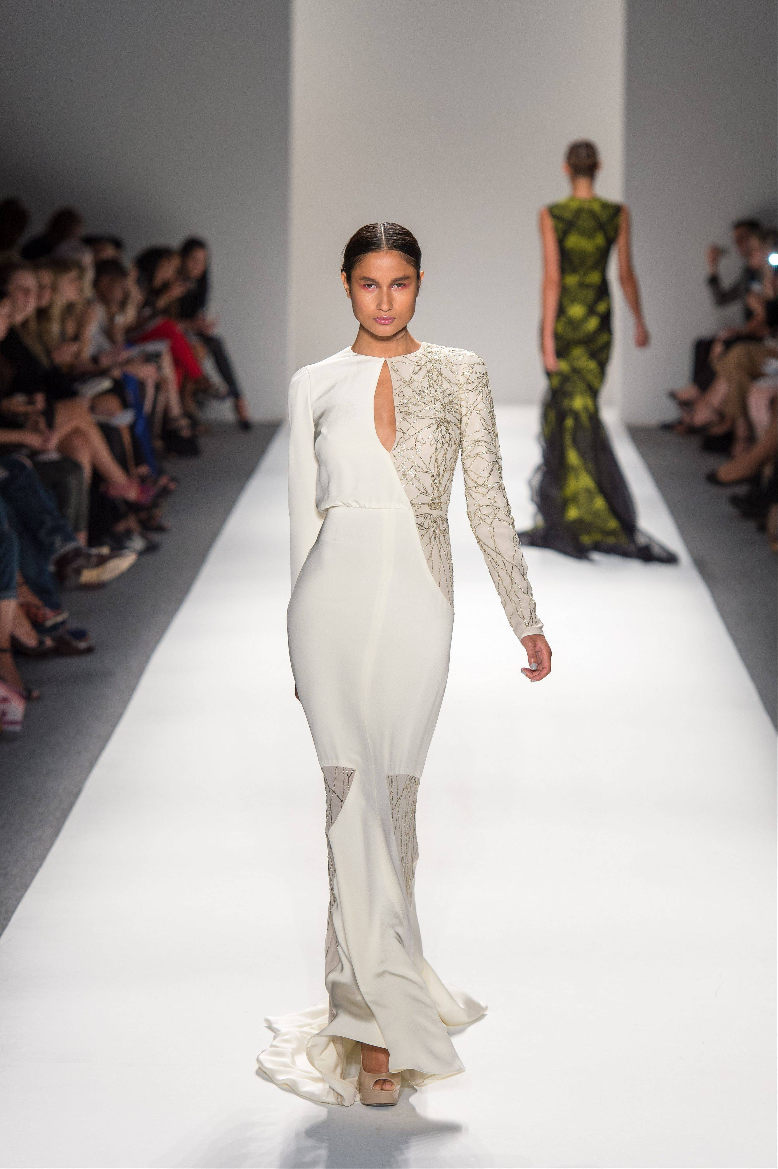 In this photo provided by Bibhu Mohapatra , the Bibhu Mohapatra Spring 2013 collection is modeled during Fashion Week in New York, Tuesday, Sept. 11, 2012.