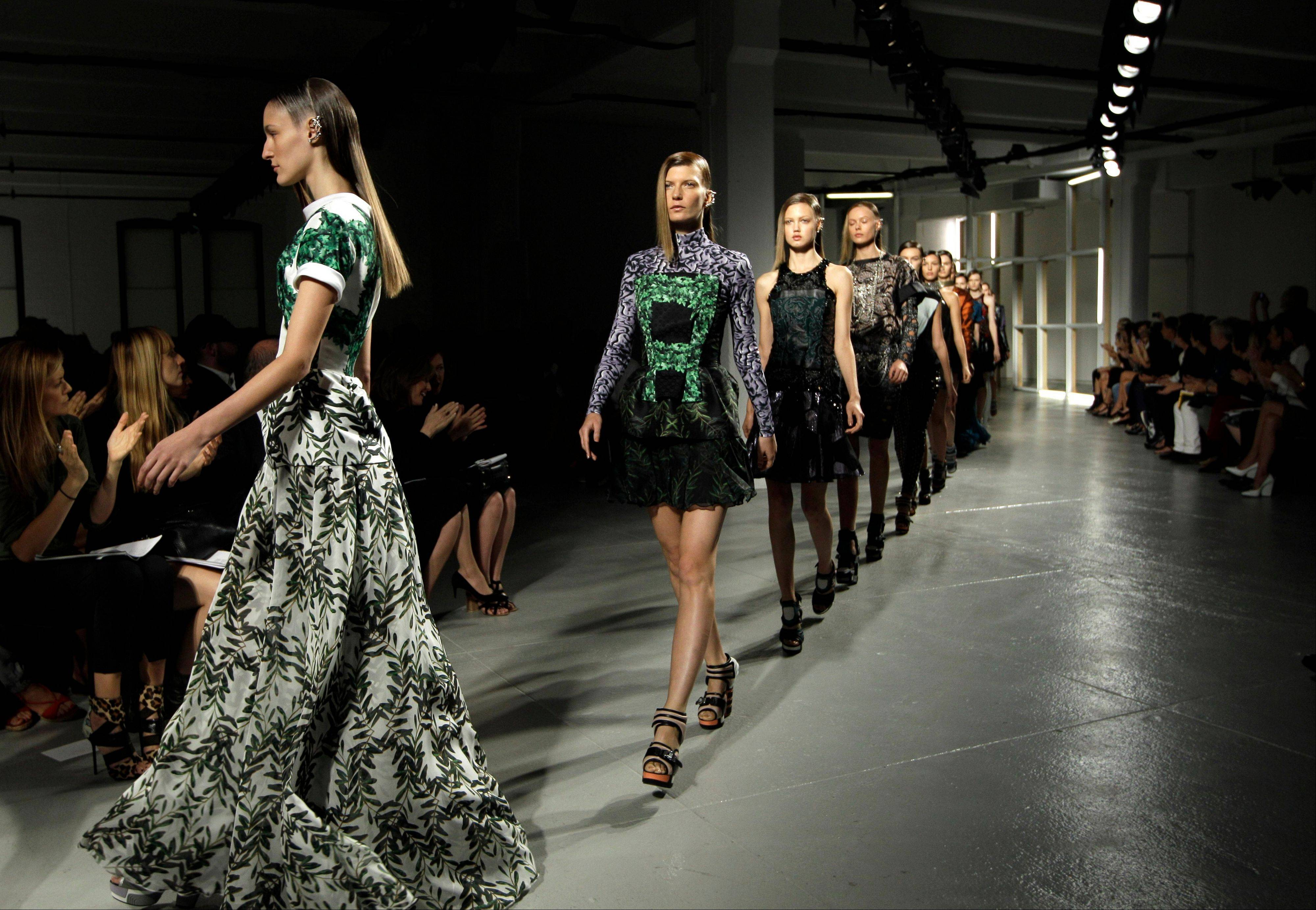 Models walk the runway during the presentation of the Rodarte Spring 2013 collection at Fashion Week in New York, Tuesday, Sept. 11, 2012.