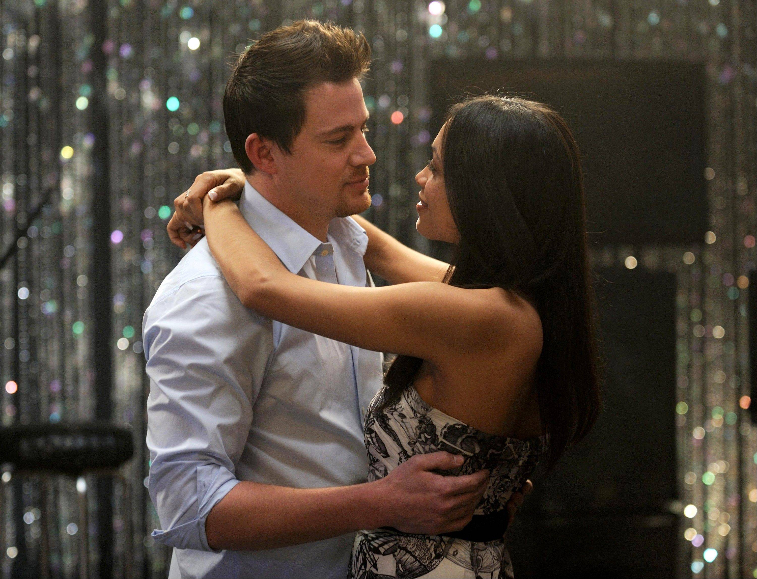 "This file photo released by Anchor Bay Films shows Channing Tatum, left, and Rosario Dawson in a scene from ""10 Years."""
