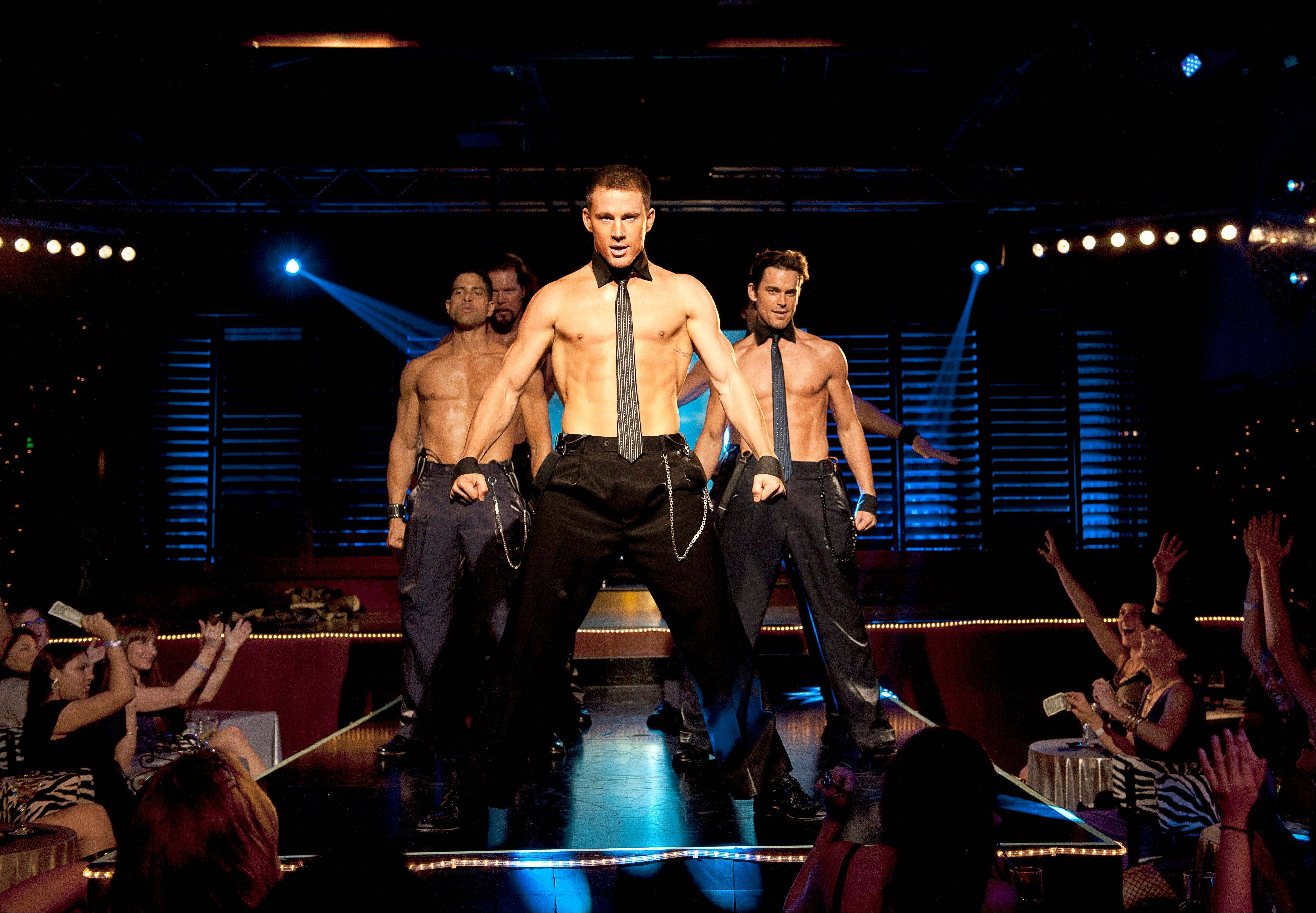 "This file photo released by Warner Bros. shows, from left, Adam Rodriguez, Kevin Nash, Channing Tatum, and Matt Bomer in a scene from ""Magic Mike."""