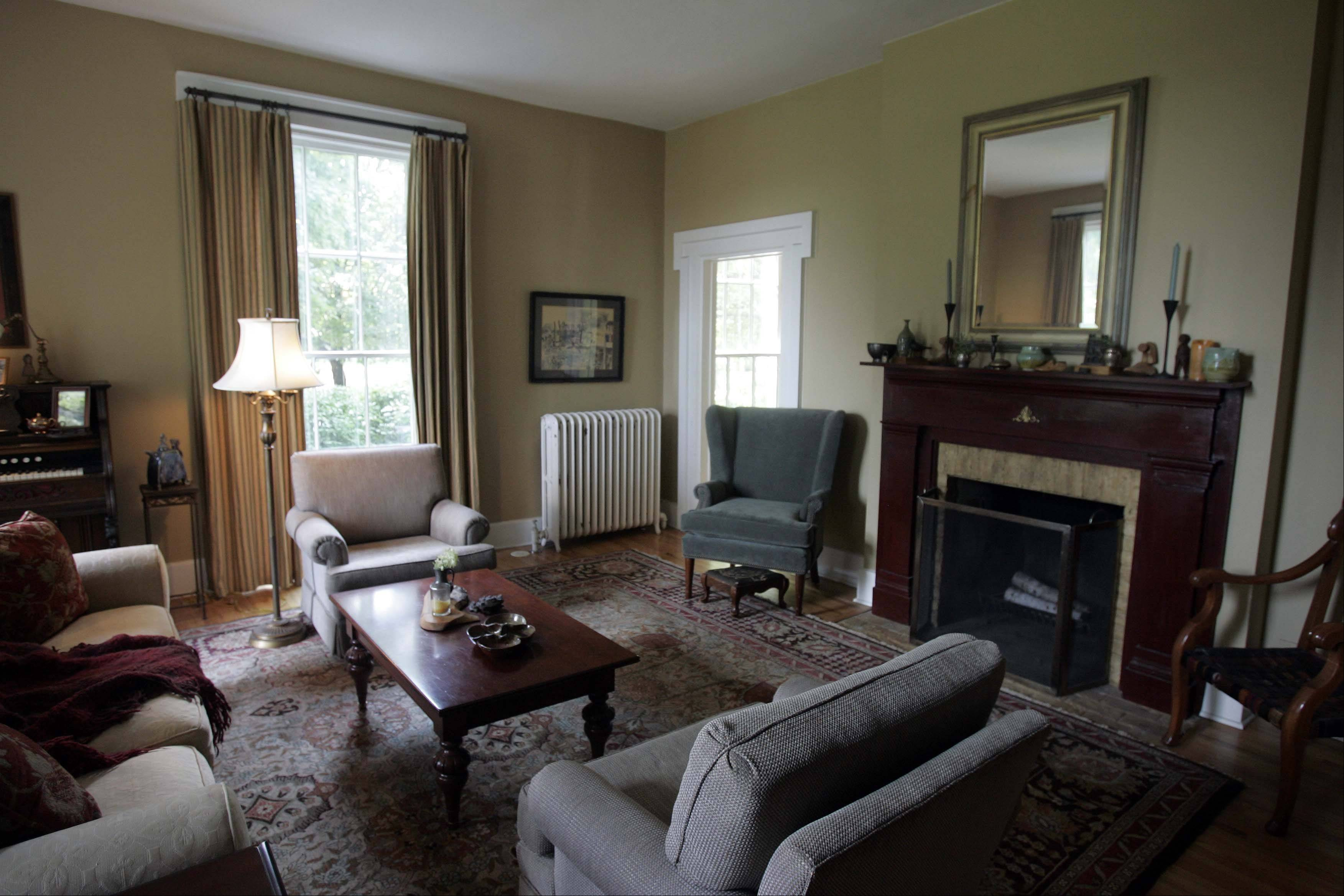 The living room of the Lewis home is complete with an original fireplace.