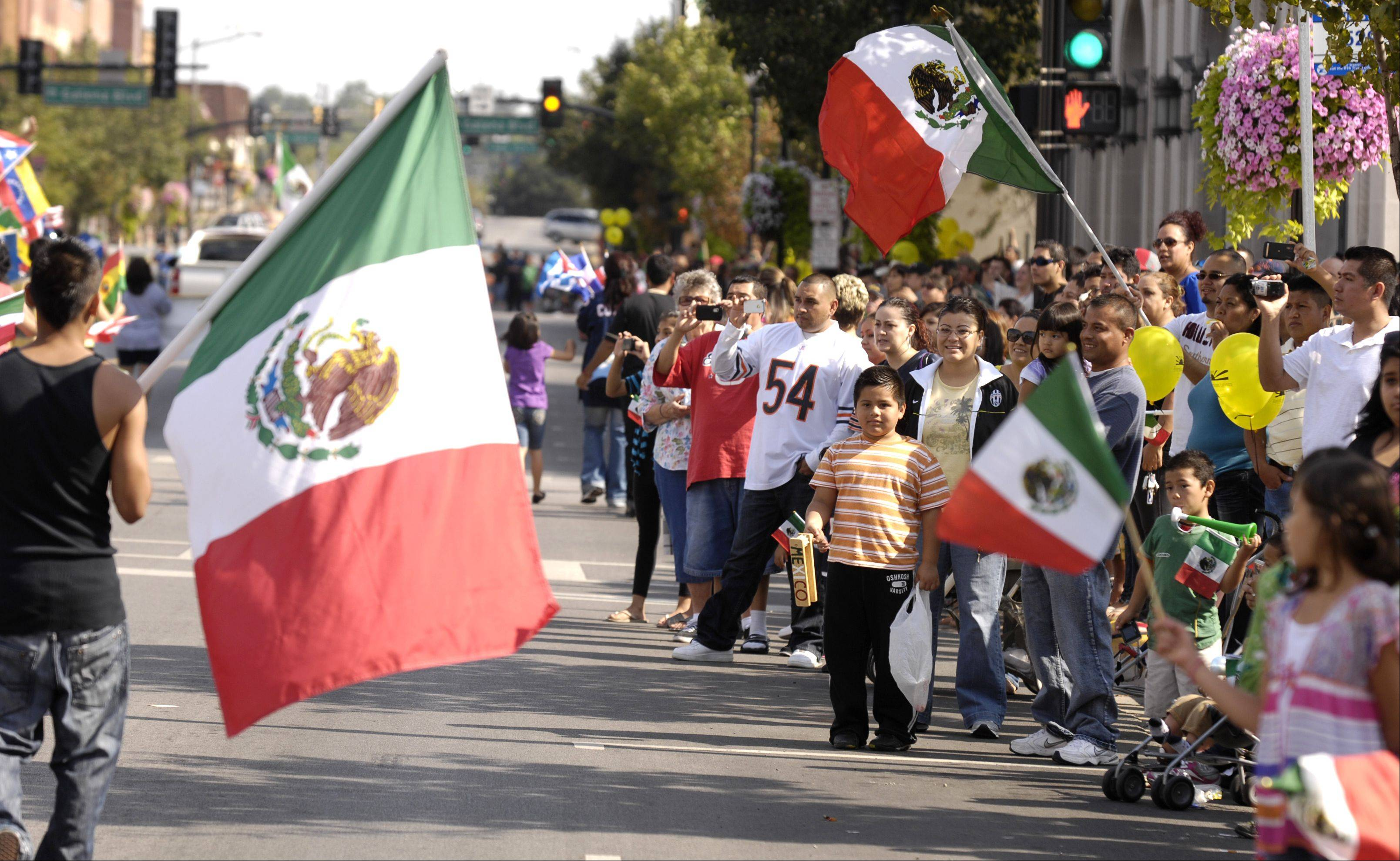 Mexican flags line the street for the third annual Fiestas Patrias parade Sunday.