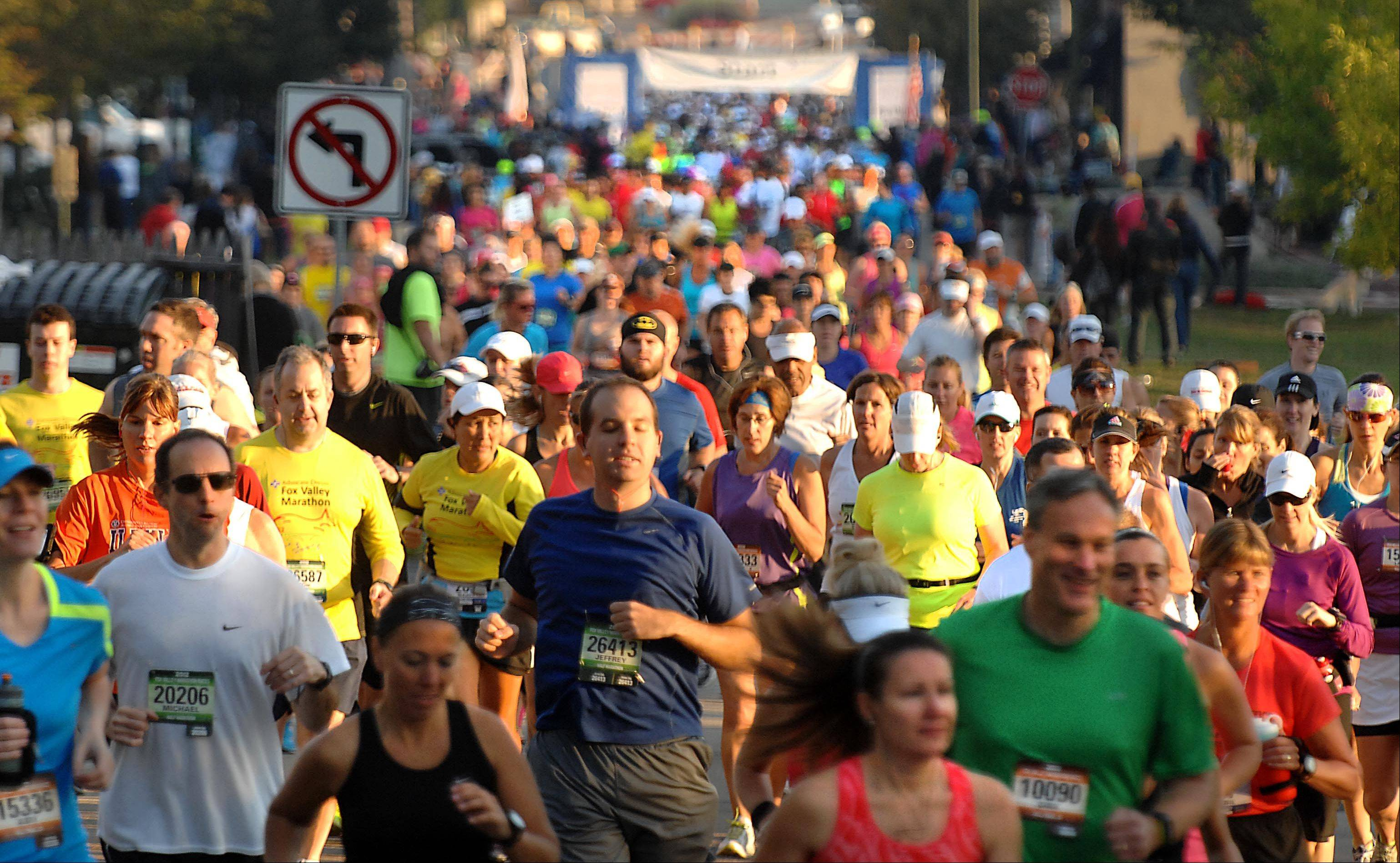 Hundreds of runners crowd First Street in St. Charles Sunday morning at the start of the Fox Valley Marathon. The top 30 finishers qualified for the prestigious Boston Marathon.