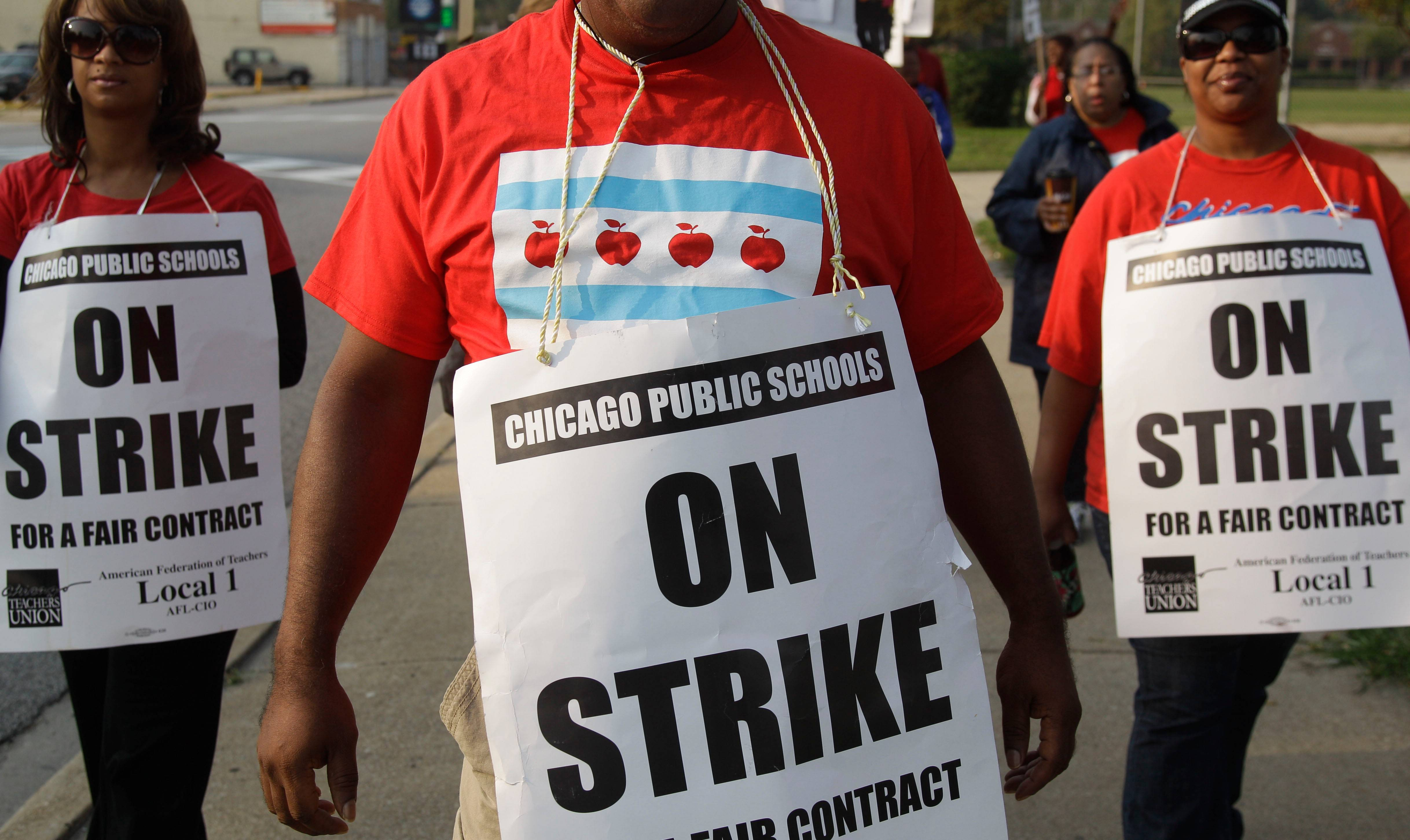 Smaller, more subdued groups of teachers picket outside Morgan Park High School in Chicago, Monday,as a strike by Chicago Teachers Union members heads into its second week. Mayor Rahm Emanuel said he will seek a court order to force the city's teachers back into the classroom.