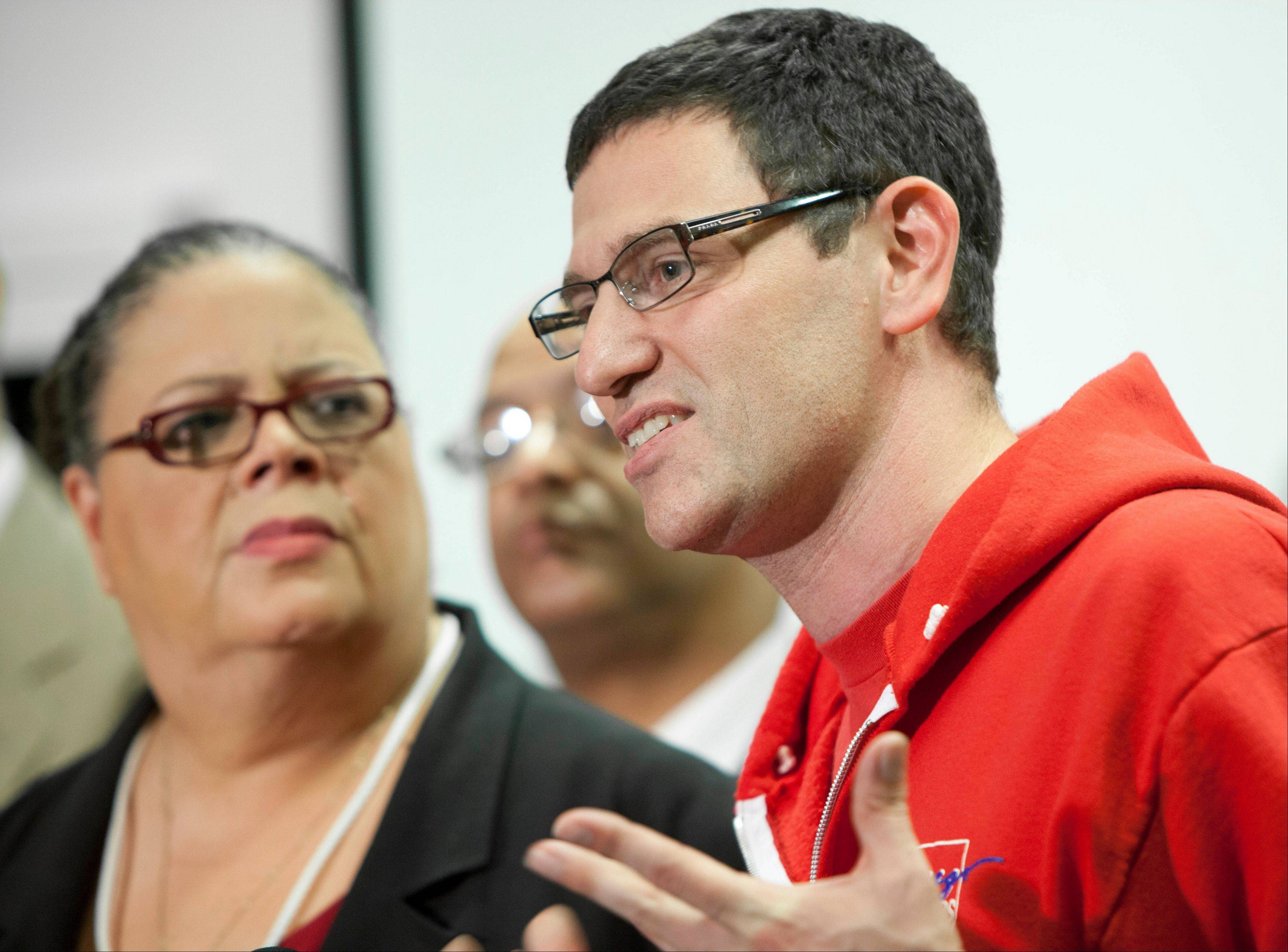 Chicago Teachers Union President Karen Lewis, left, listens to CTU Vice President Jesse Sharkey speak Sunday at a press conference following a meeting of delegates in Chicago. The Chicago teachers union decided Sunday to continue its weeklong strike, extending an acrimonious standoff with Mayor Rahm Emanuel over teacher evaluations and job security provisions central to the debate over the future of public education across the United States.