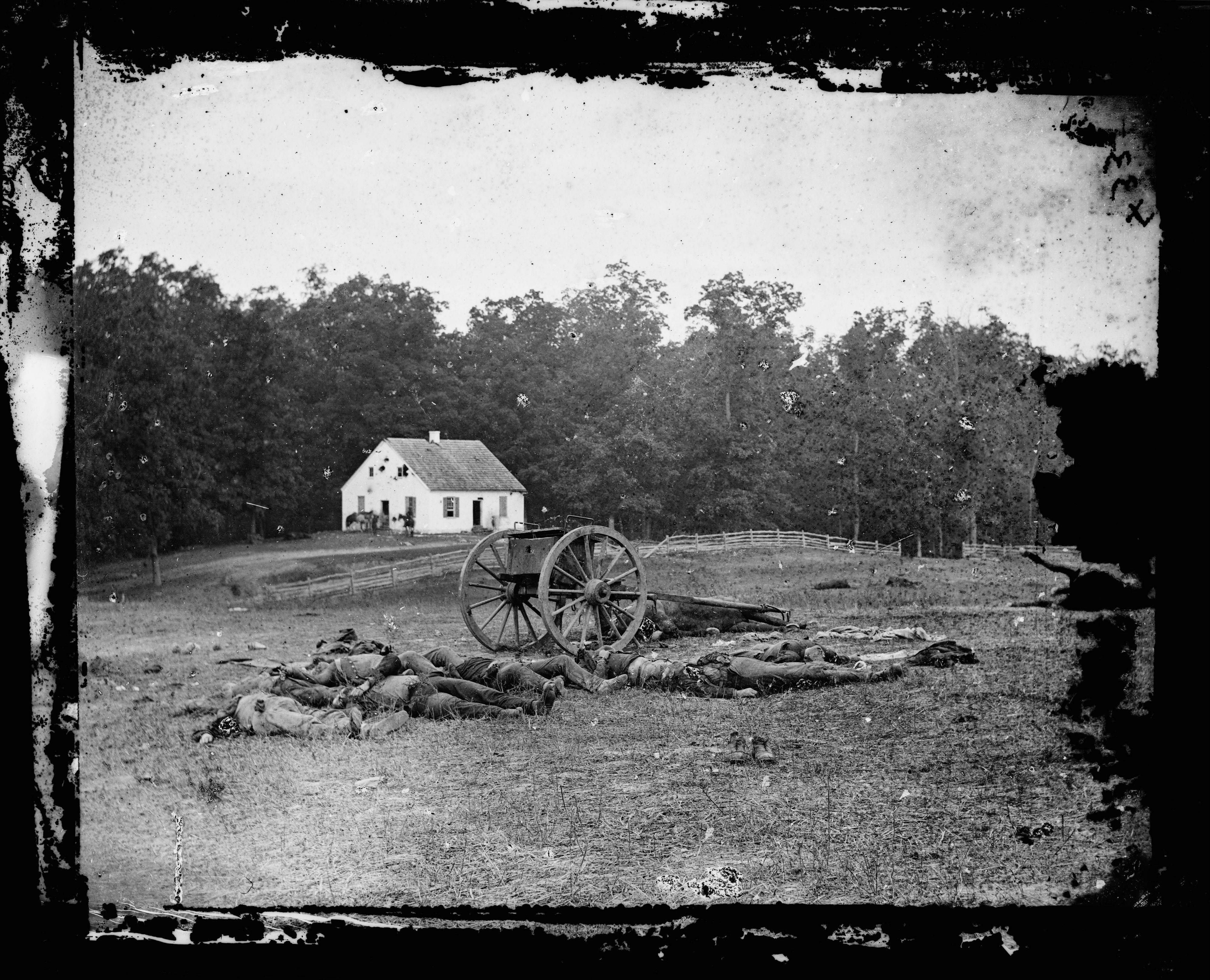 This 1862 photograph made available by the Library of Congress shows casualties from the Battle of Antietam near the church of the pacifist Dunker sect near Sharpsburg, Md.