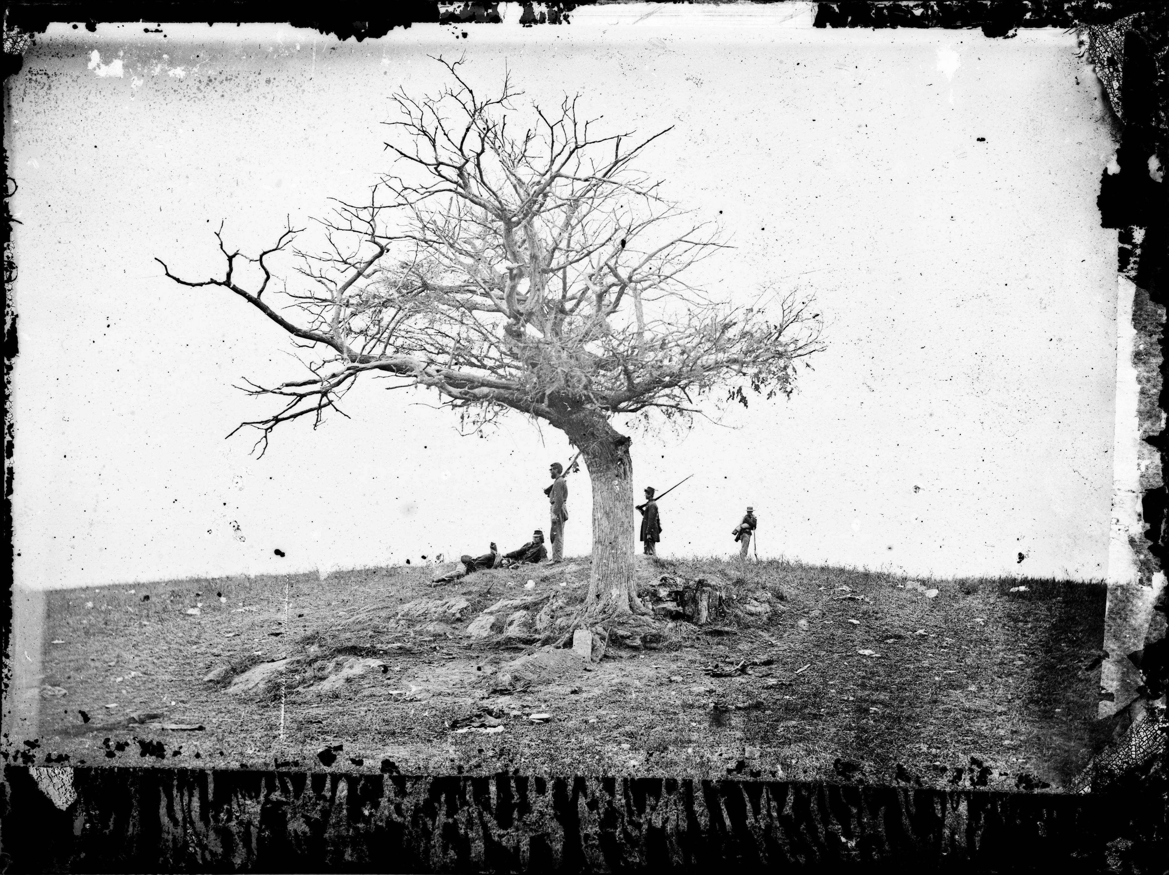 This 1862 photo made available by the Library of Congress shows soldiers next to a lone grave after the Battle of Antietam near Sharpsburg, Md. When dawn broke along Antietam Creek on Sept. 17, 1862, cannon volleys launched a Civil War battle that would leave 23,000 casualties on the single bloodiest day in U.S. history and mark a crucial pivot point in the war.