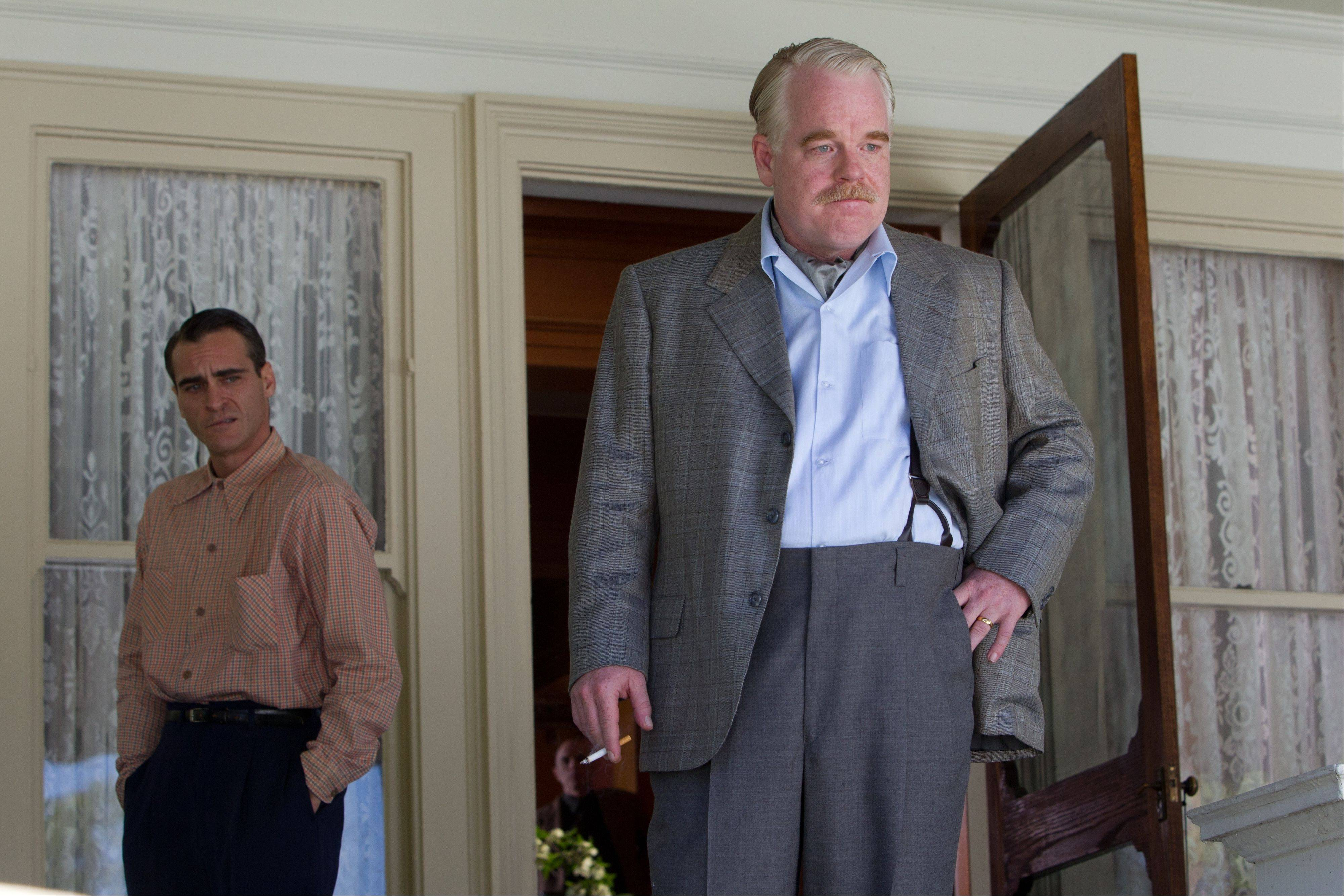 "This film image released by The Weinstein Co. shows Joaquin Phoenix, left, and Philip Seymour Hoffman in a scene from ""The Master."" The film, which was released in only five theaters made an average of $145,949 per screen, follows Hoffman who plays a charistmatic cult leader and Phoenix his protege and is loosely based on L. Ron Hubbard and Scientology."