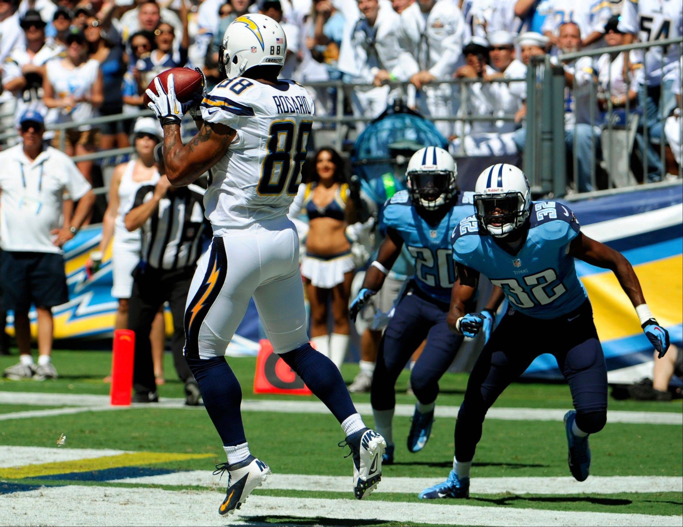 San Diego Chargers tight end Dante Rosario makes a touchdown catch in the end zone as Tennessee Titans strong safety Robert Johnson, right, and cornerback Alterraun Verner, center, watch during the first quarter in San Diego.