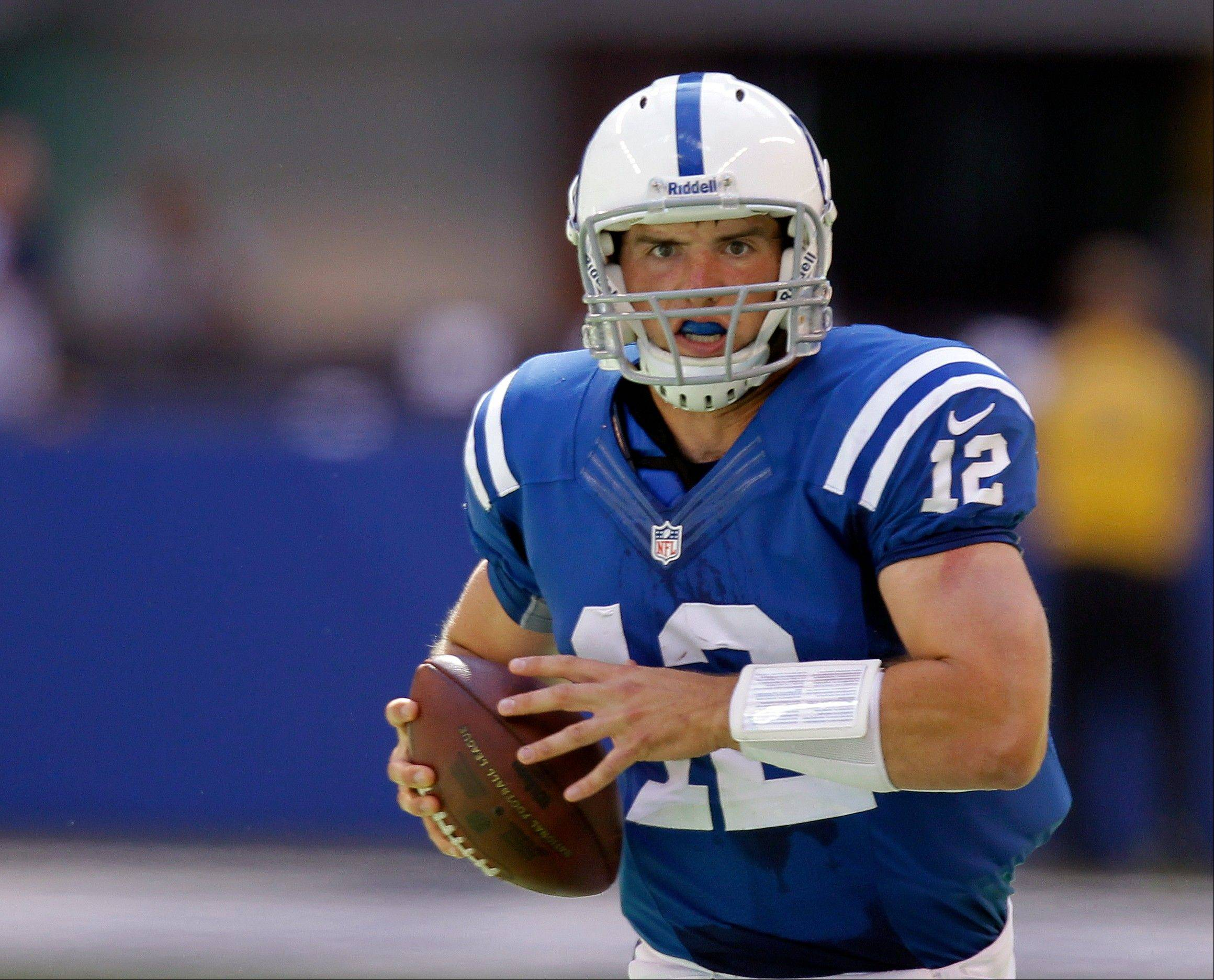 Indianapolis Colts' Andrew Luck runs during the first half against the Minnesota Vikings in Indianapolis.