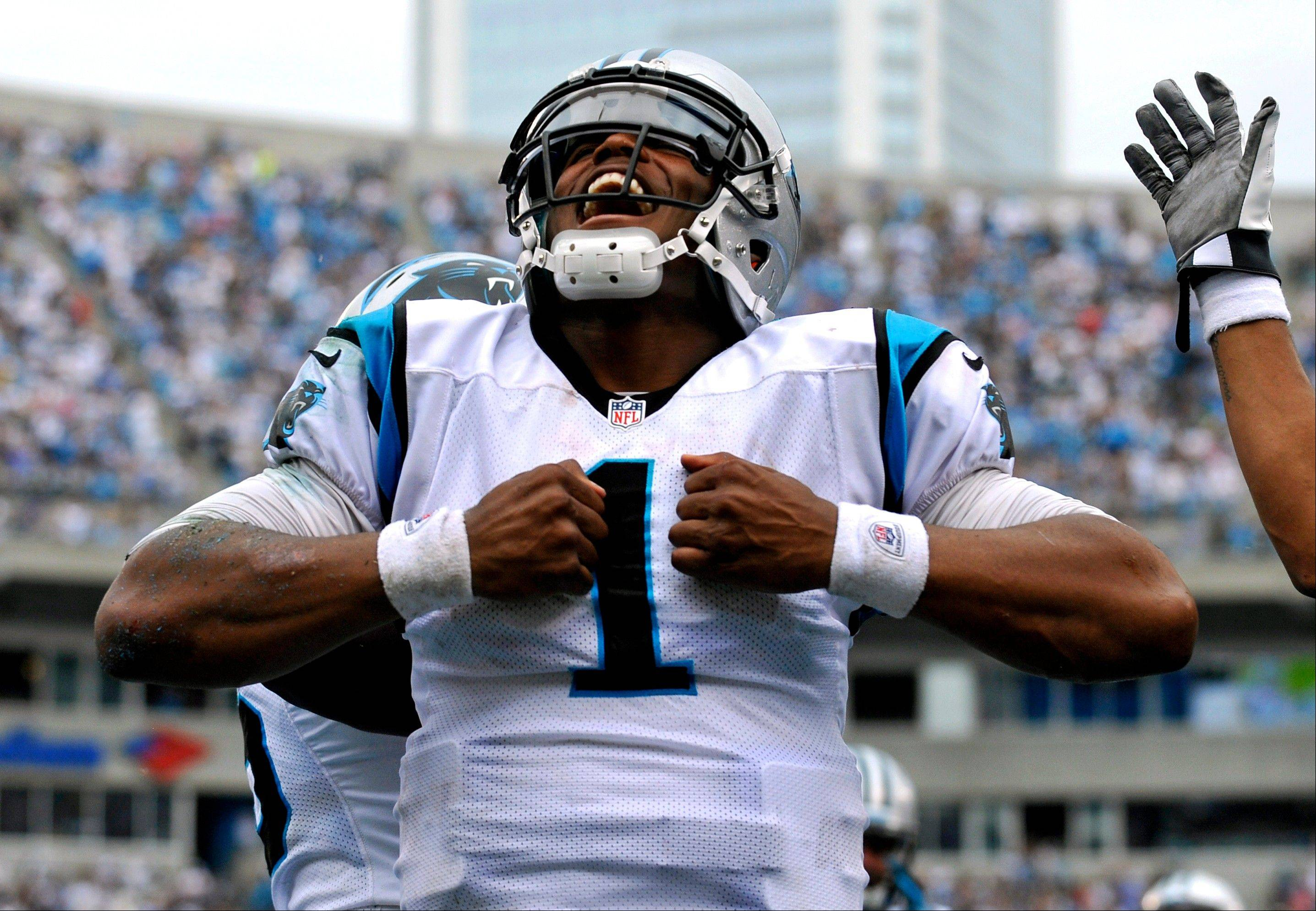 Carolina Panthers' Cam Newton (1) reacts after running for a touchdown against the New Orleans Saints during the fourth quarter in Charlotte, N.C.