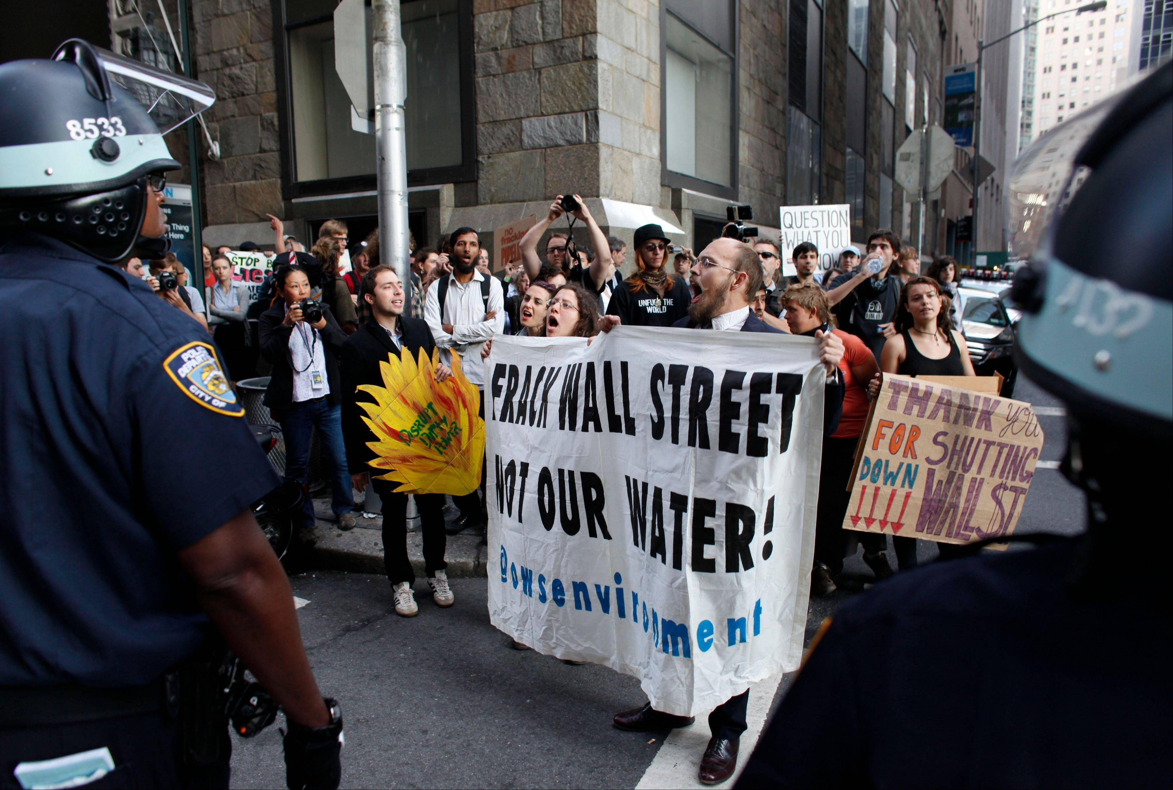 Protestors and police face off during an Occupy Wall Street march Monday in New York. More than 100 Occupy Wall Street protestors were arrested during marches and demonstrations around New York�s financial district on the anniversary of the grass-roots movement.