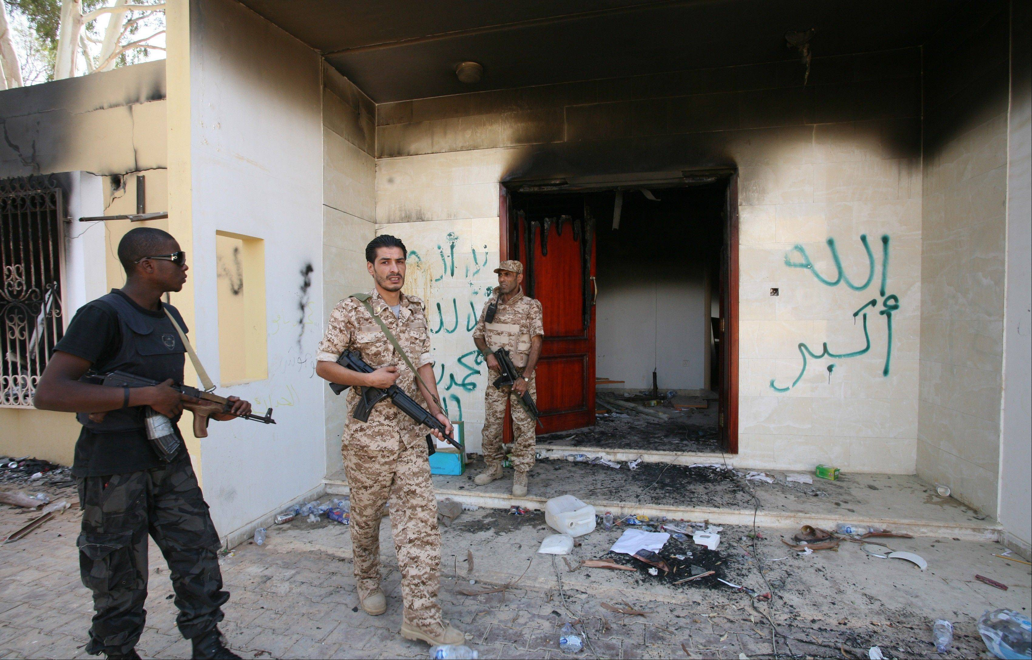 Libyan military guards check one of the U.S. Consulate�s burnt buildings in Benghazi, Libya, Friday. The American ambassador to Libya and three other Americans were killed when a mob of protesters and gunmen overwhelmed the U.S. Consulate in Benghazi, setting fire to it.