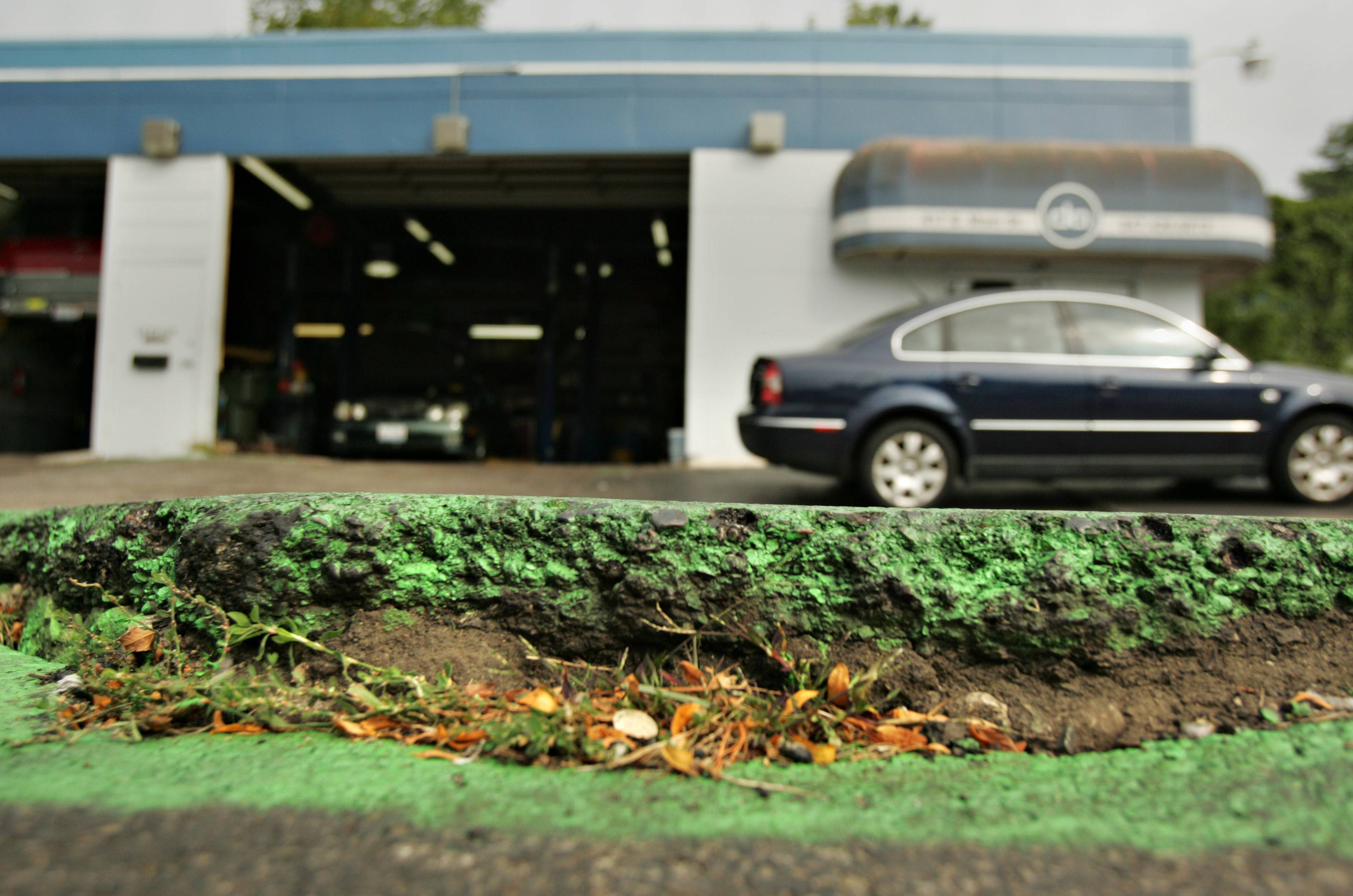 The asphalt in front of Dundee Automotive has buckled more than five inches in the last few days. Employees spray painted the crack when it was even.