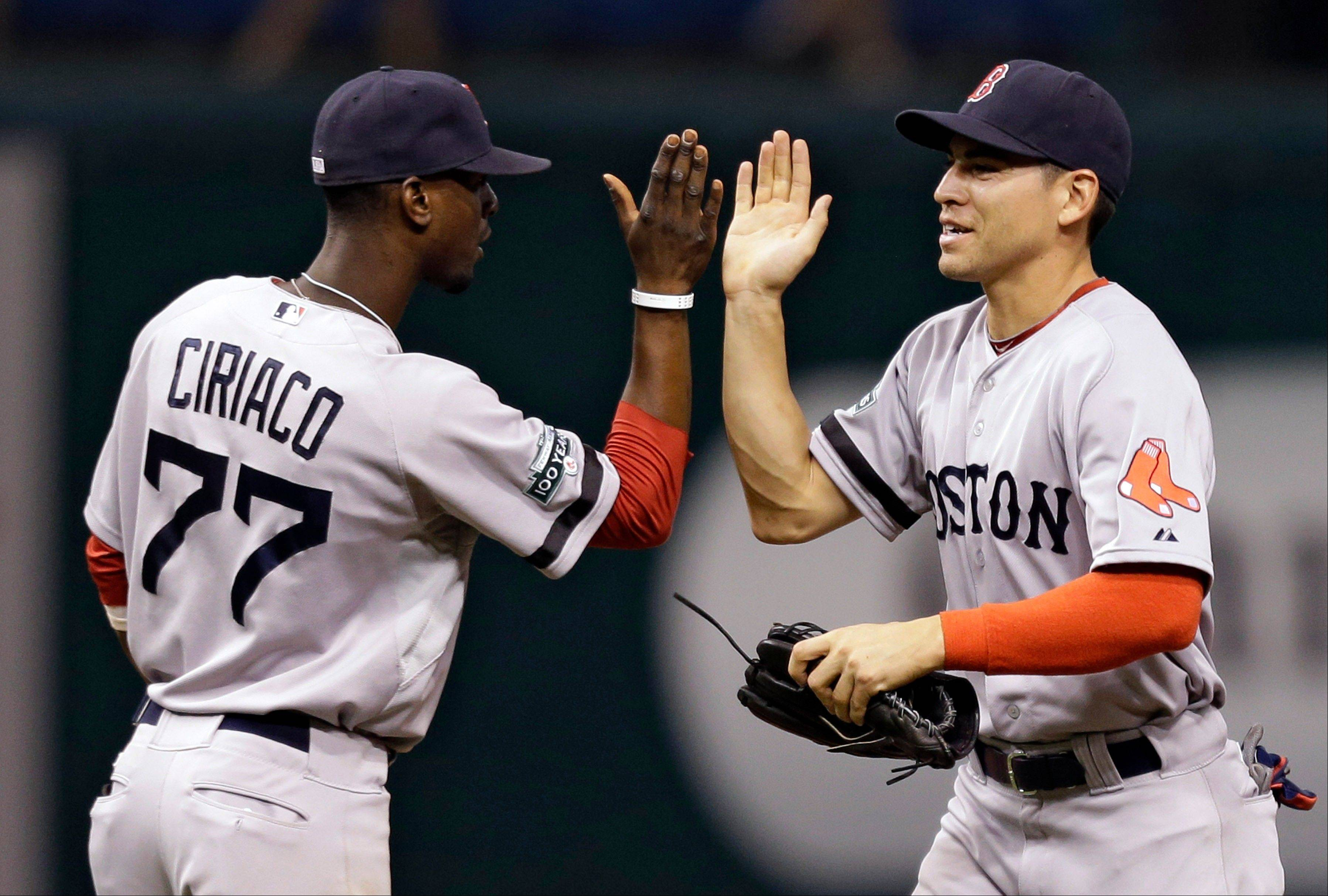 Boston�s Jacoby Ellsbury, right, high-fives teammate Pedro Ciriaco after the Red Sox defeated the Tampa Bay Rays 5-2 on Monday in St. Petersburg, Fla.