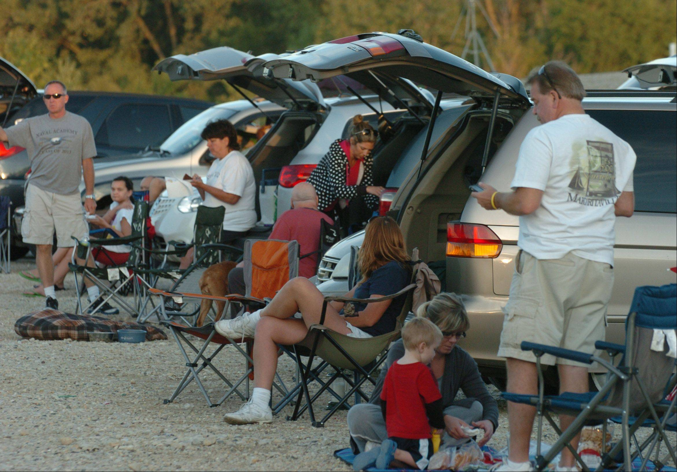 Families prepare for show time at the Cascade Drive-In Theater in West Chicago.