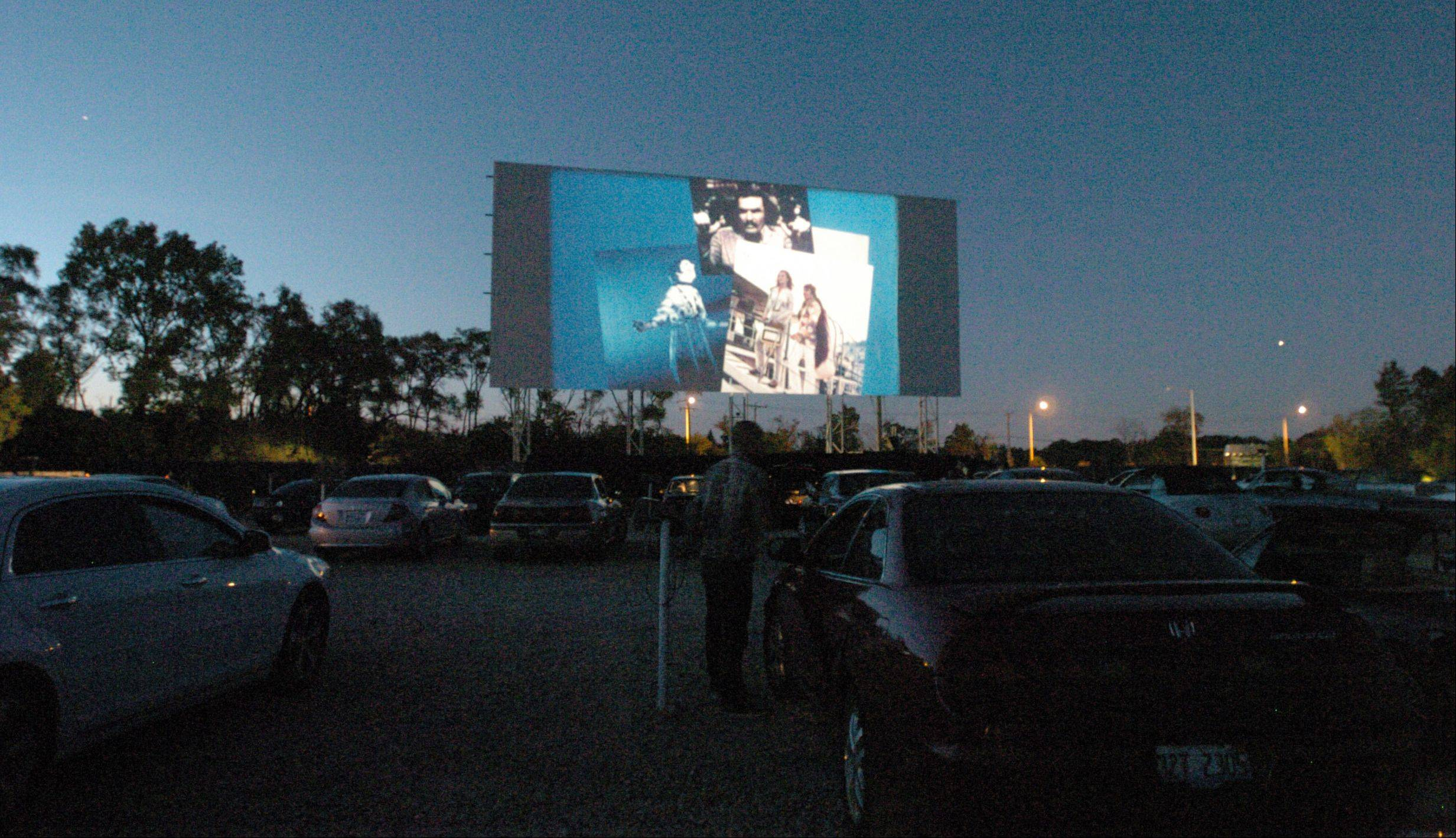 A double-feature begins at the Cascade Drive-In Theater in West Chicago.