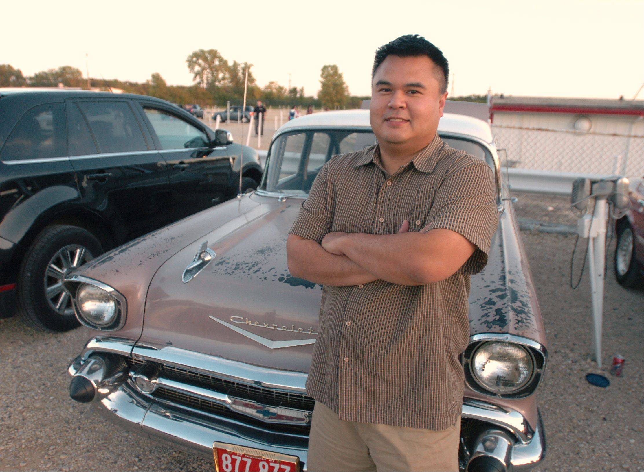 "Rush Luangsuwan of Woodridge frequents the Cascade Drive-In Theater in West Chicago weekly, often in his 1957 Chevy. ""I encourage my friends to come here as much as possible because you don't know when it might close,"" he said."