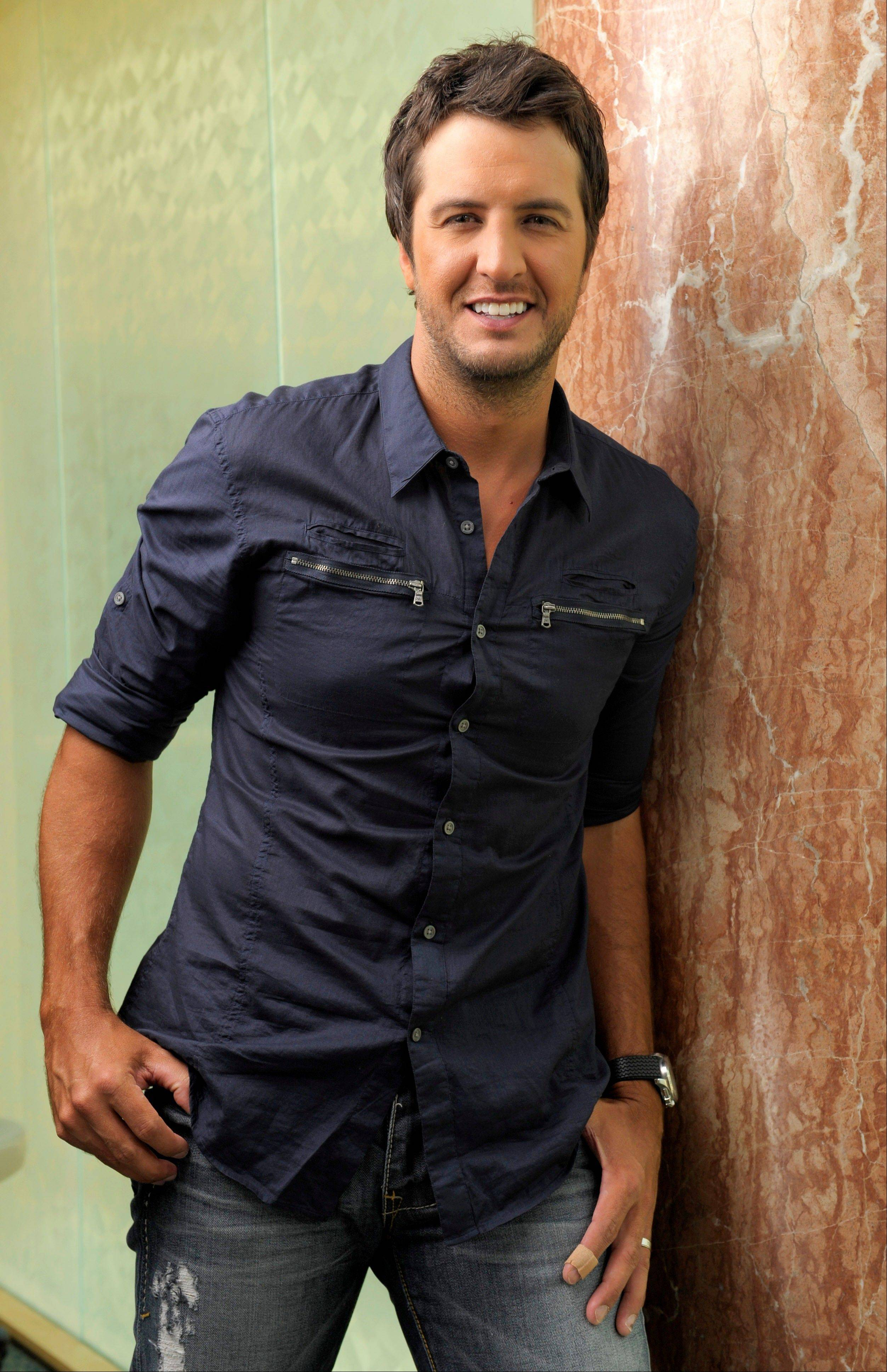"Country music artist Luke Bryan and The Band Perry's Kimberly Perry are co-hosts for the three-hour TV special ""CMA Music Festival: Country's Night to Rock"" on ABC."