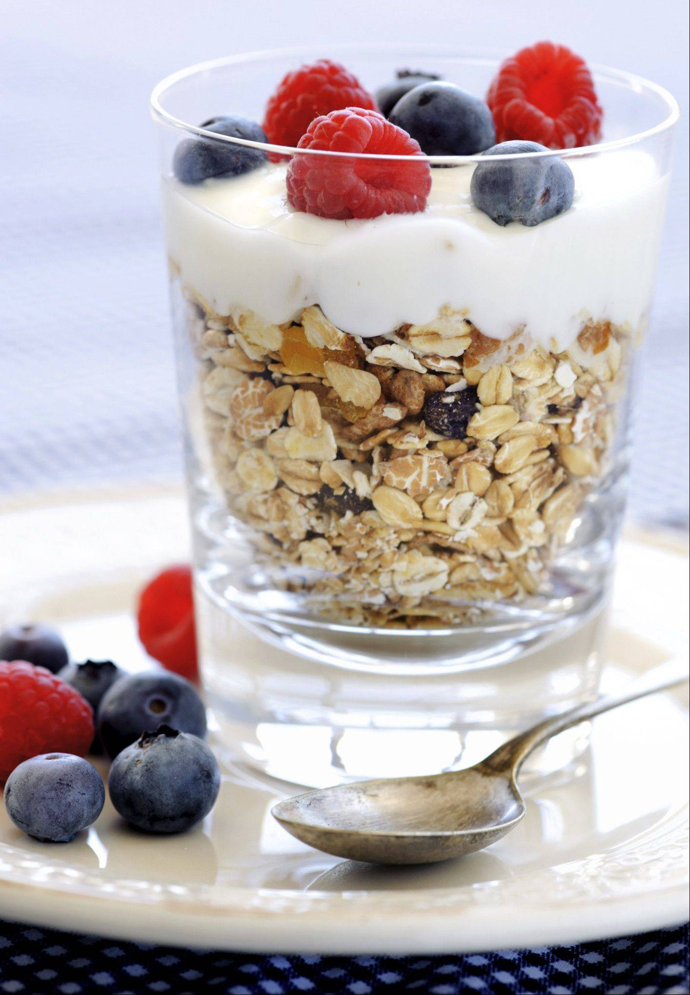 A yogurt parfait with oats or walnuts is a good meal to eat to start your day.