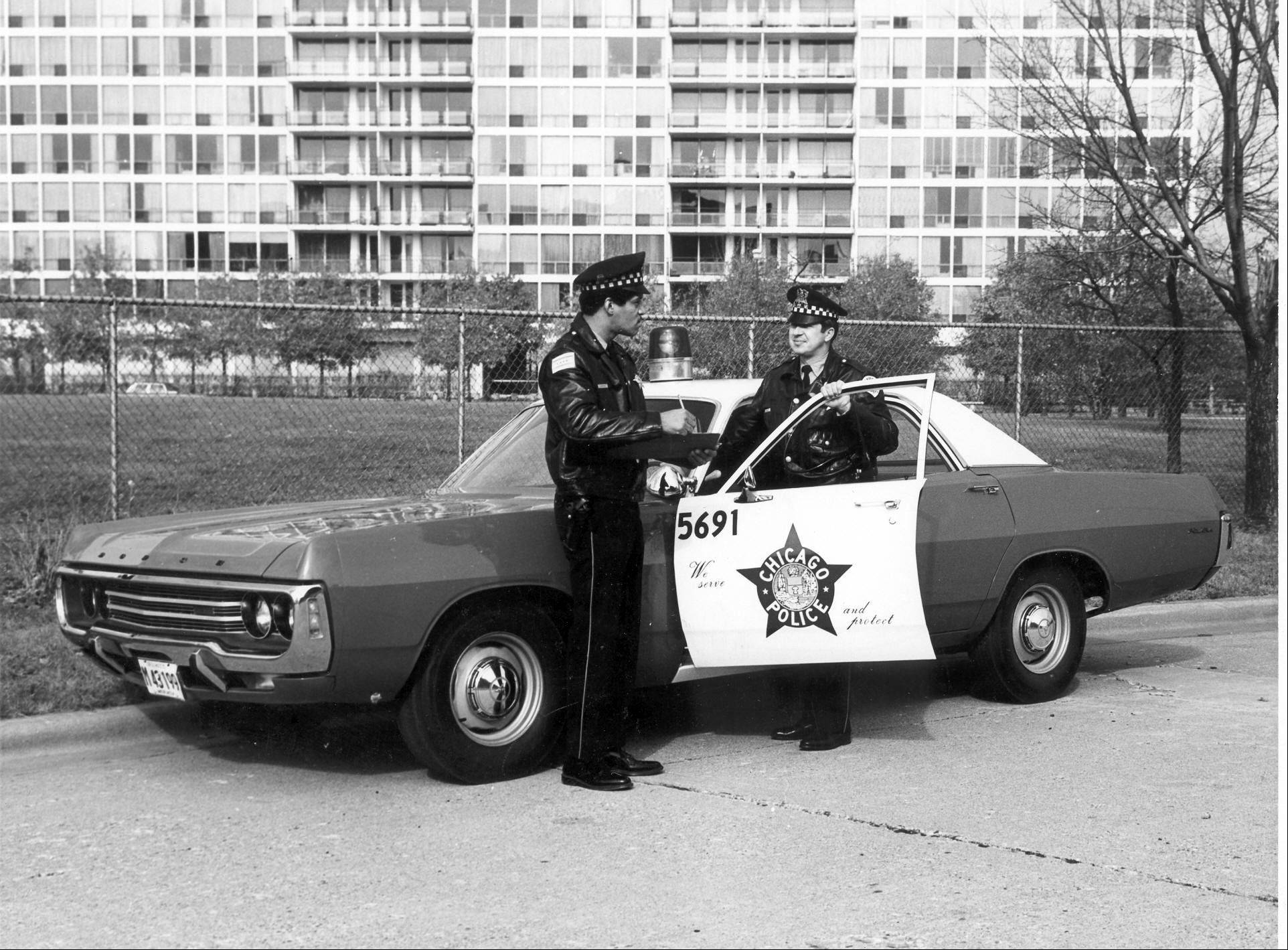 Reynolds used old photographs, like this one showing a 1971 Dodge Polara, to re-create his Chicago Police Department squad.