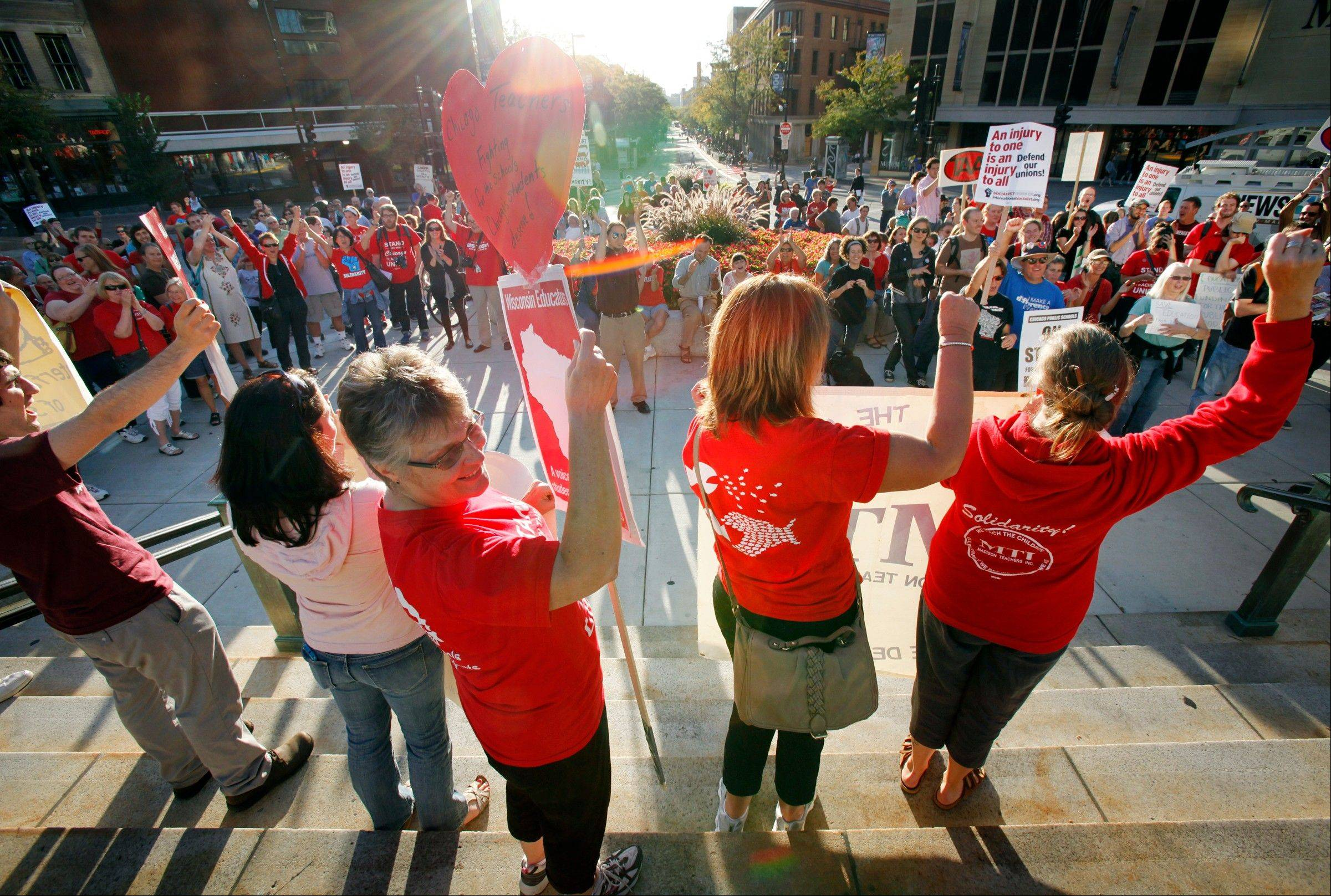 Teachers cheer during a rally at the Wisconsin state Capitol in Madison on Friday.