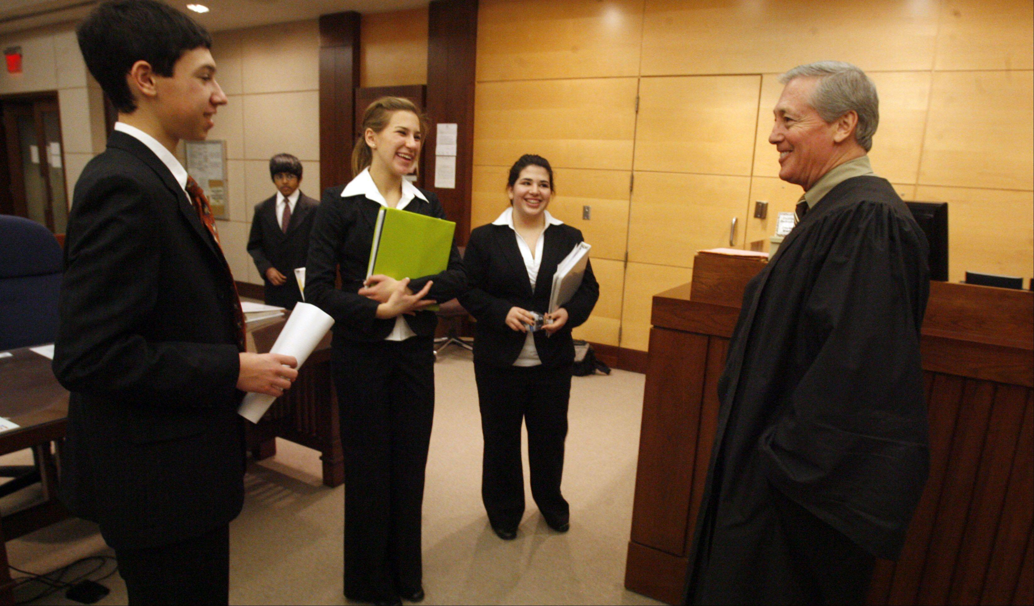 Hinsdale High School students talk to Judge Timothy Sheldon after the 10th annual St. Charles Mock Trial Tournament in 2008 at the Kane County Judicial Center in St. Charles.