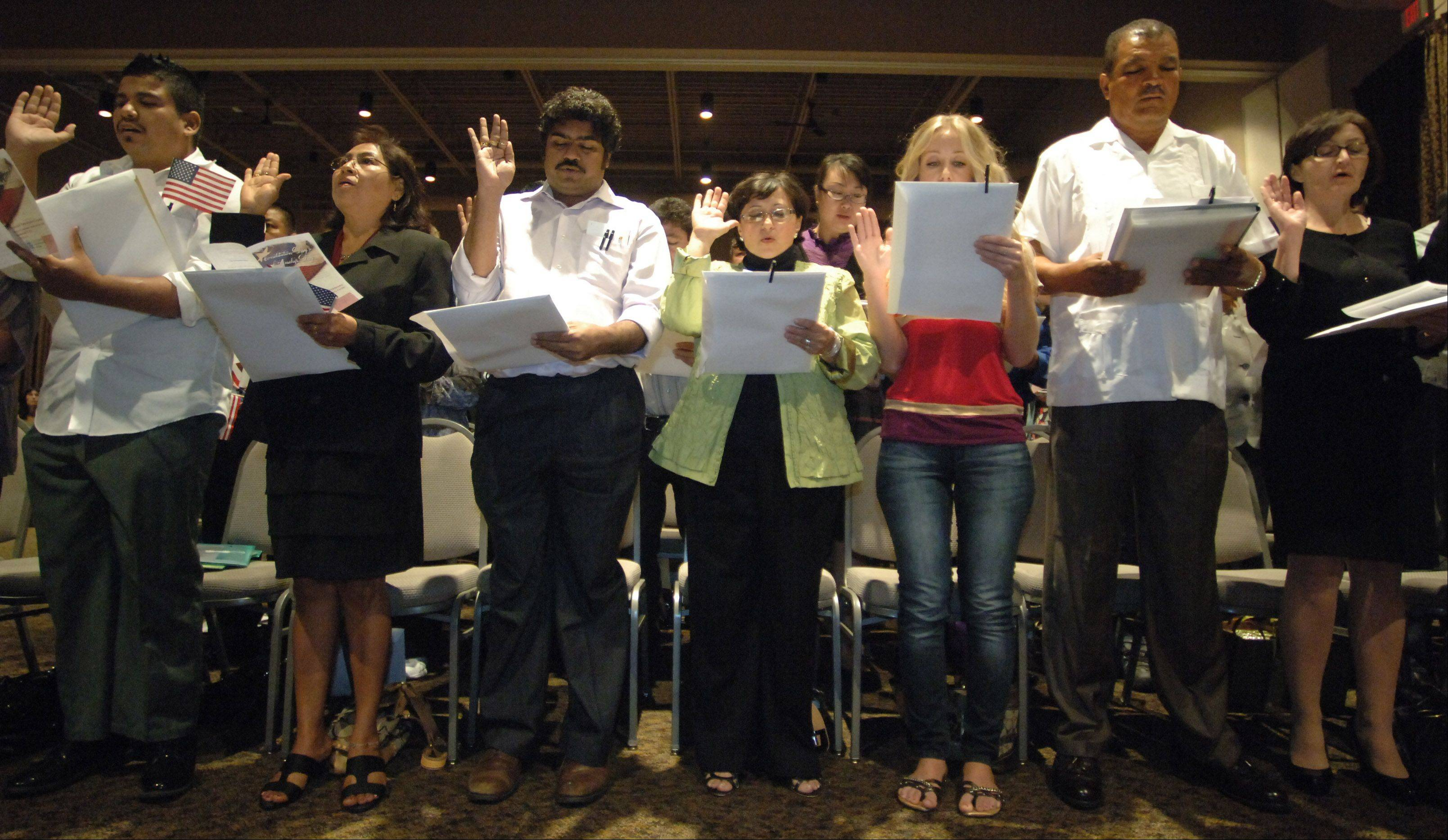 About 100 people became United States citizens Monday during a naturalization ceremony at the Round Lake Beach Cultural & Civic Center. The new citizens hail from 33 countries.