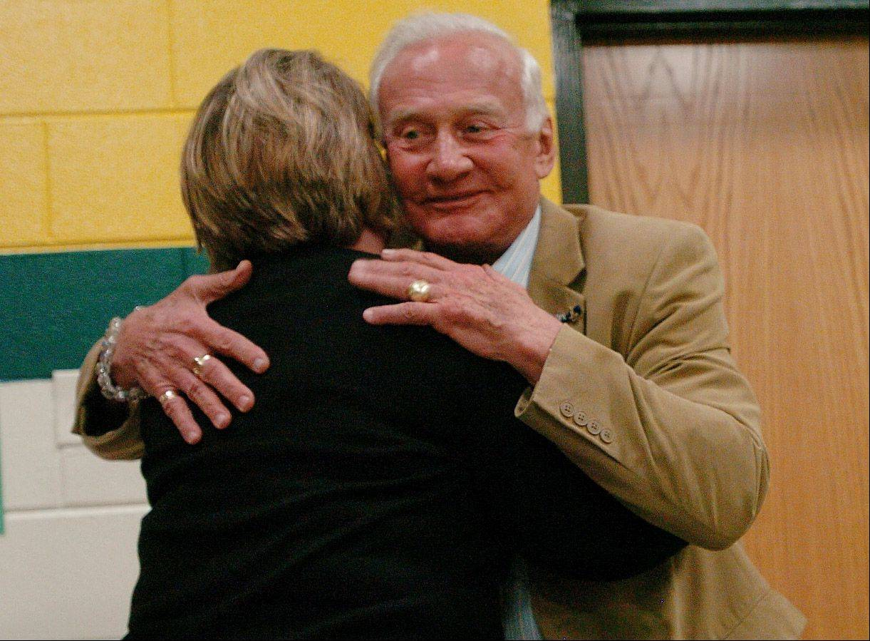 Astronaut Buzz Aldrin hugs Principal Mary Botterman at the Schaumburg elementary school which was named after him in 1971.