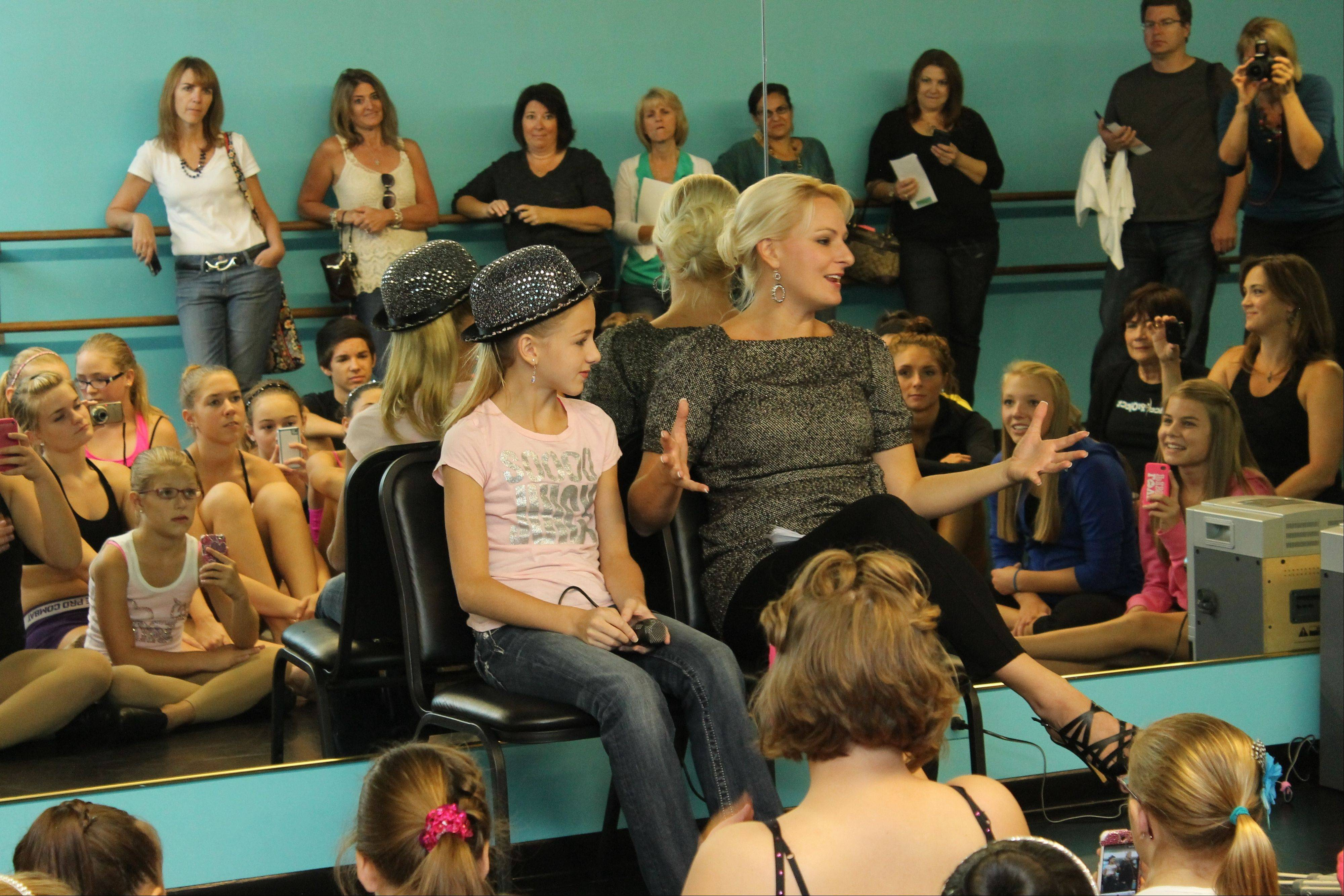 "Chloe Lukasiak and her mom, Christi, from Lifetime's reality TV show ""Dance Moms"" take part in a question-and-answer session with students at the Dance Project dance studio in Hoffman Estates. The mother-daughter duo visited the studio Saturday."