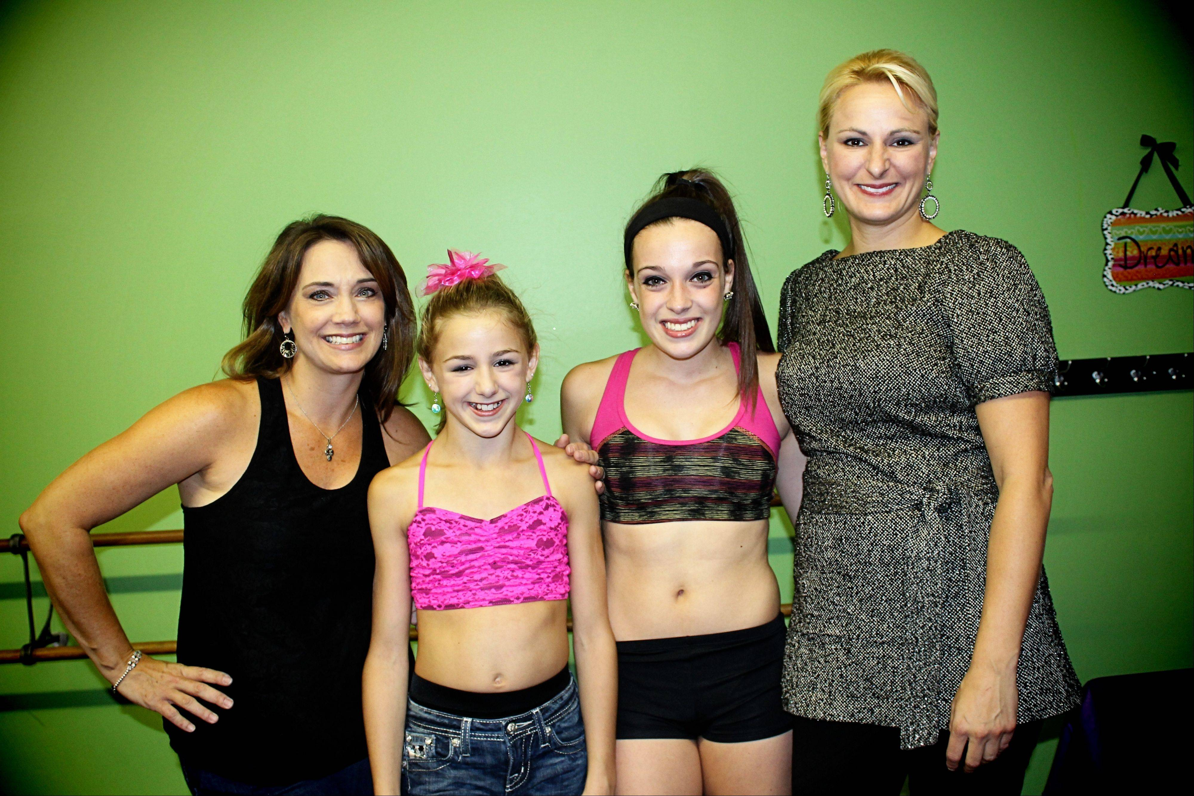 "Dance Project dance studio director Lisa Gomez, far left, and her 16-year-old daughter, Sarah, second to right, with 11-year-old Chloe Lukasiak, second to left, and her mom, Christi, far right, of the Lifetime reality TV show ""Dance Moms."" The mother-daughter duo visited the Hoffman Estates studio Saturday."