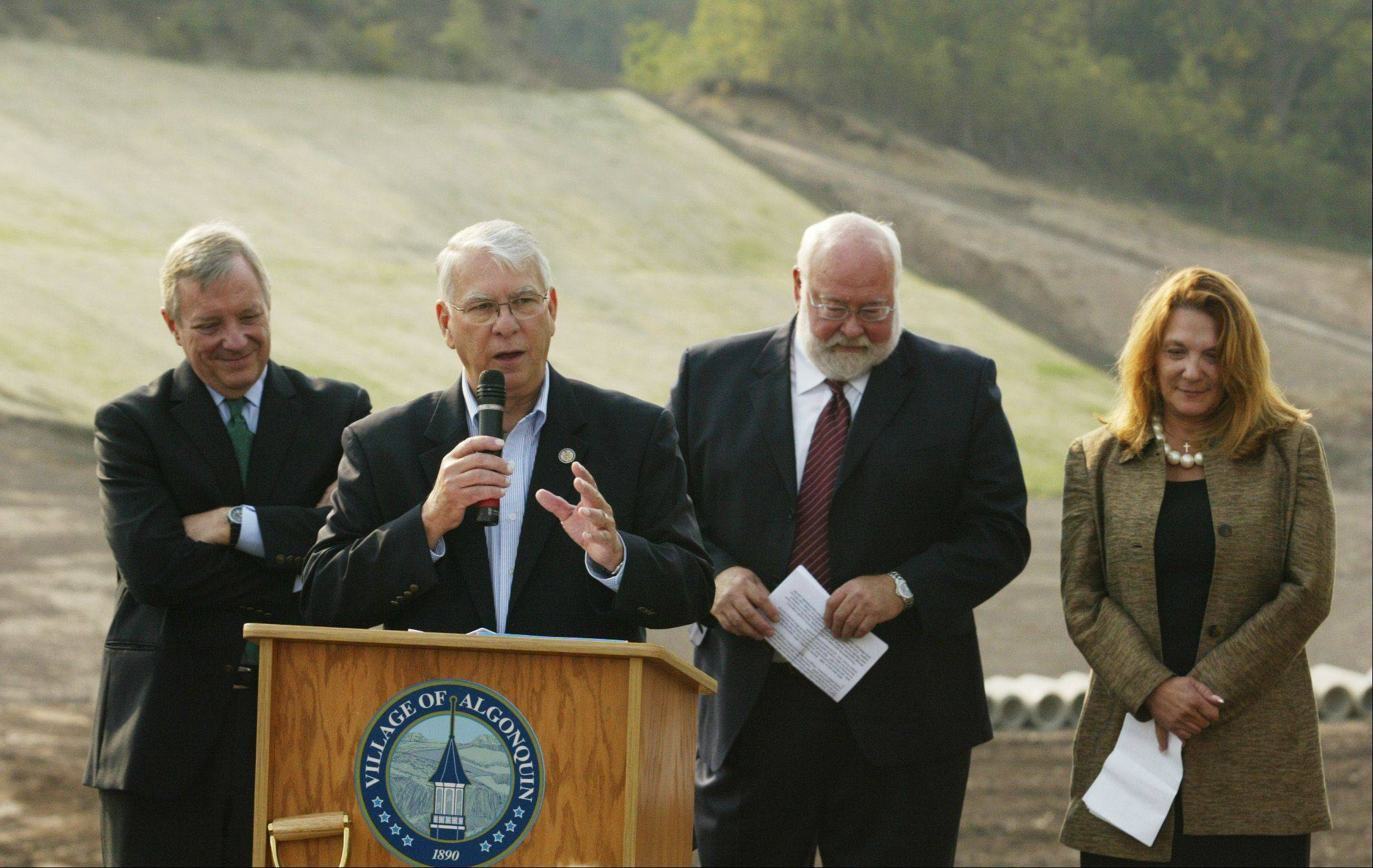 Congressman Don Manzullo addresses the crowd Monday during the official groundbreaking ceremony for the western bypass in Algonquin. Behind him from left are Sen. Dick Durbin, Algonquin Village President John Schmitt, and State Sen. Pam Althoff.