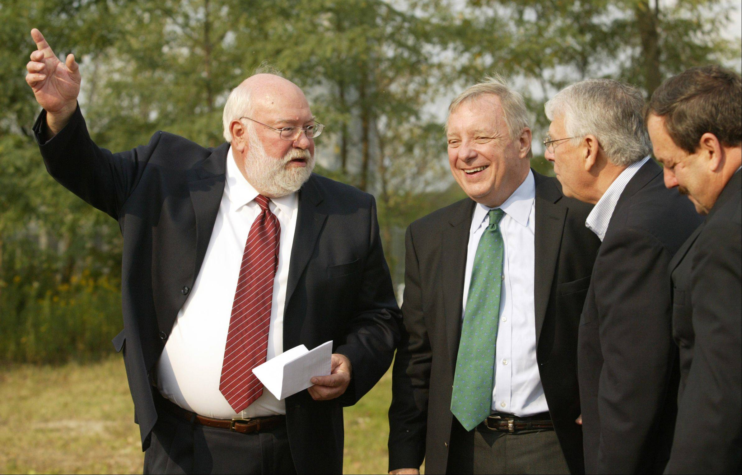 Algonquin Village President John Schmitt, left, jokes with Sen. Dick Durbin and Rep. Don Manzullo prior to Monday's groundbreaking ceremony for the western bypass project. At far right is engineering consultant Gary Overbay.